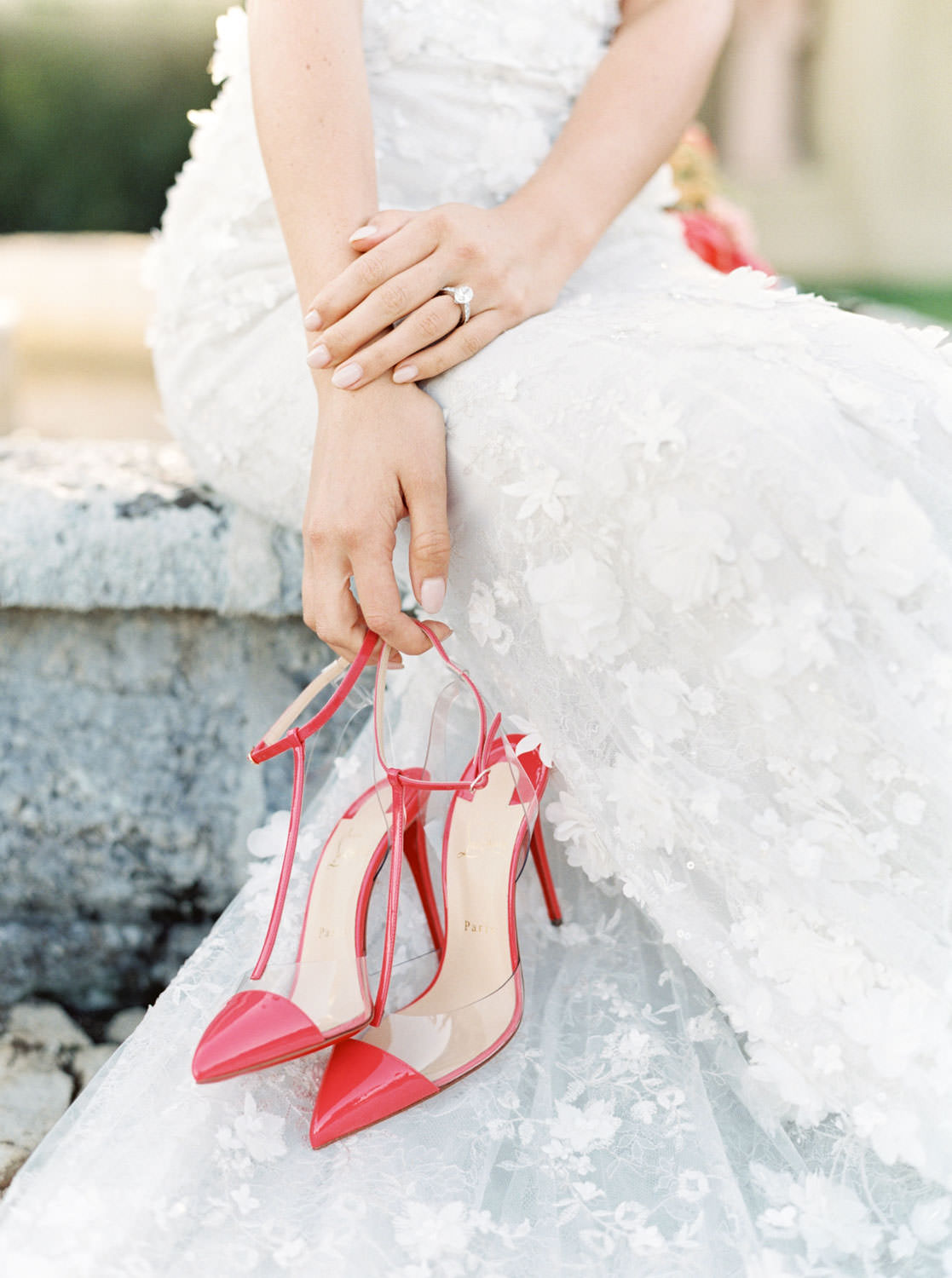 Bride in Marchesa gown with pink Louboutin pumps in her hands, film by Cavin Elizabeth Photography - Santa barbara wedding photographer