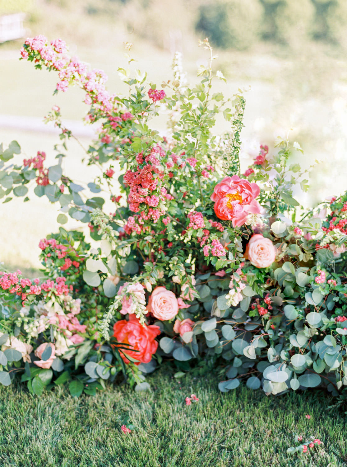 Ceremony semi circle floral arrangement with greenery and pink flowers, Whispering Rose Ranch wedding shot on film, Cavin Elizabeth Photography