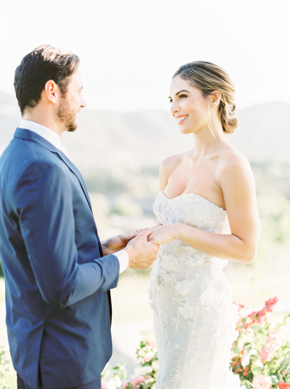 Bride in Marchesa and groom for ceremony, Ceremony semi circle floral arrangement with greenery and pink flowers, Whispering Rose Ranch wedding shot on film, Cavin Elizabeth Photography
