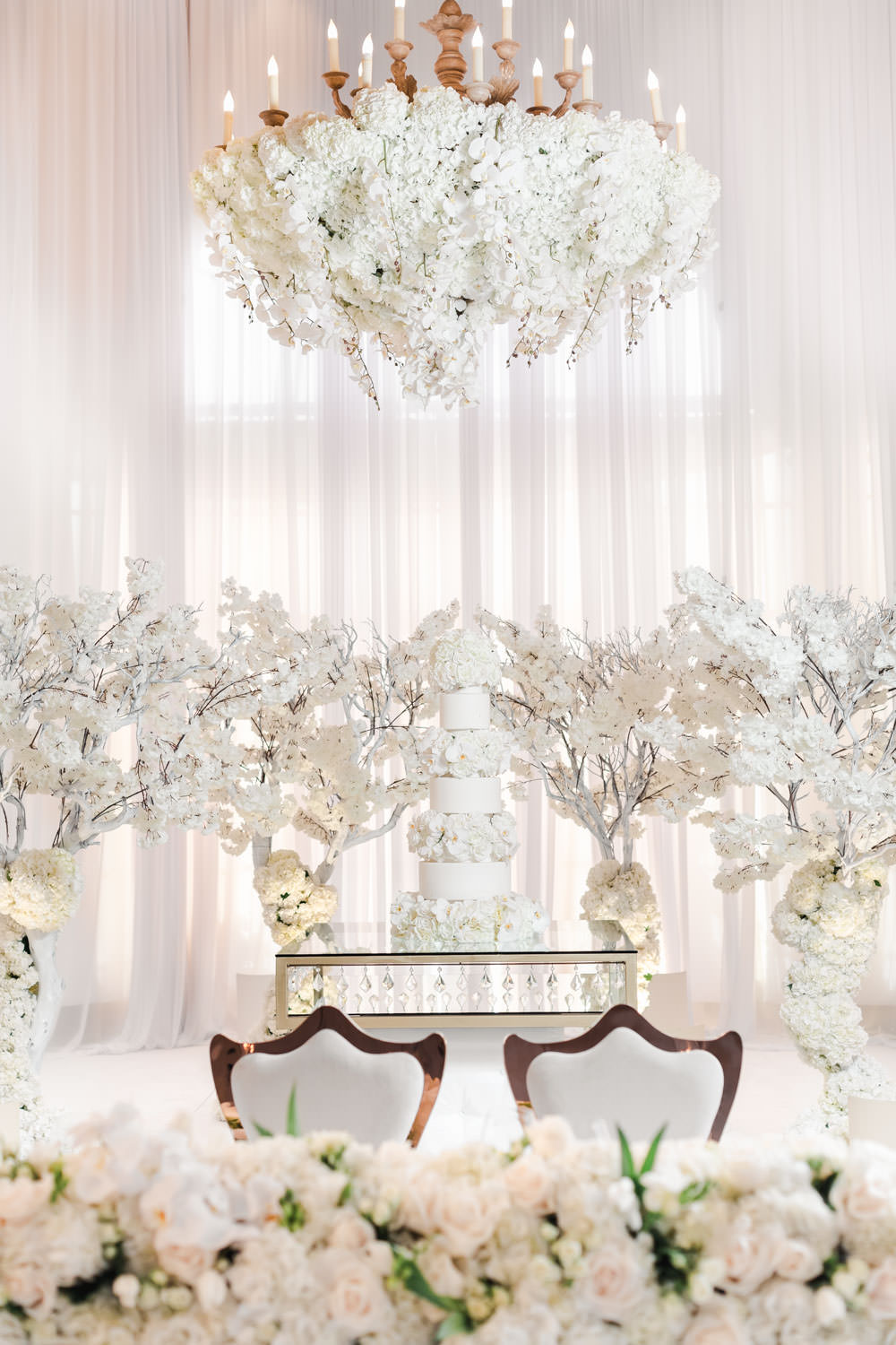 White reception seven tier cake alternating cake and flowers with white draping and carpet ceremony Pelican Hill Wedding - Cavin Elizabeth Photography