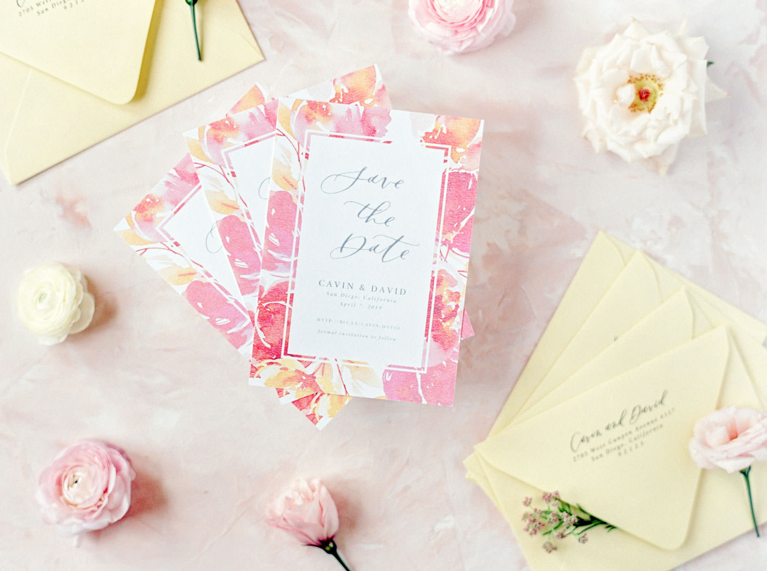 Colorful save the dates and color palette, Custom Save the Date Cards Twinkle and Toast with white paper and grey text and a floral border with pink peach and yellow paired with yellow envelopes, Cavin Elizabeth Photography