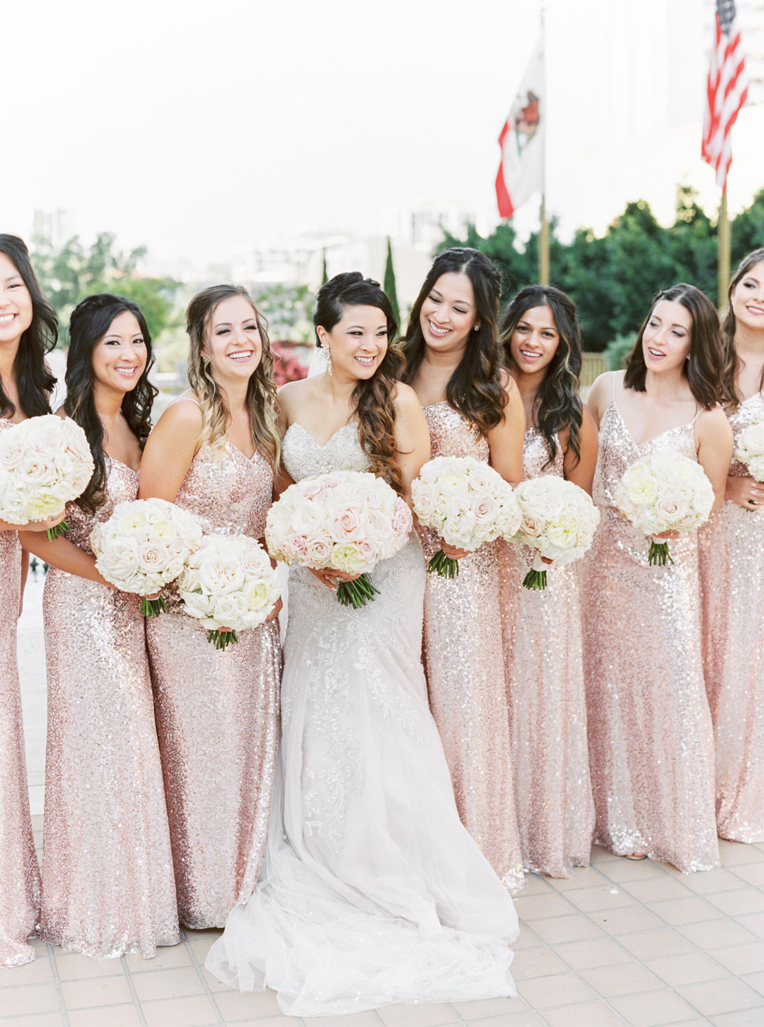 Bridal party portrait of bridesmaids in pink blush sequin gowns, Westgate Hotel Wedding in Downtown San Diego, Cavin ELizabeth Photography