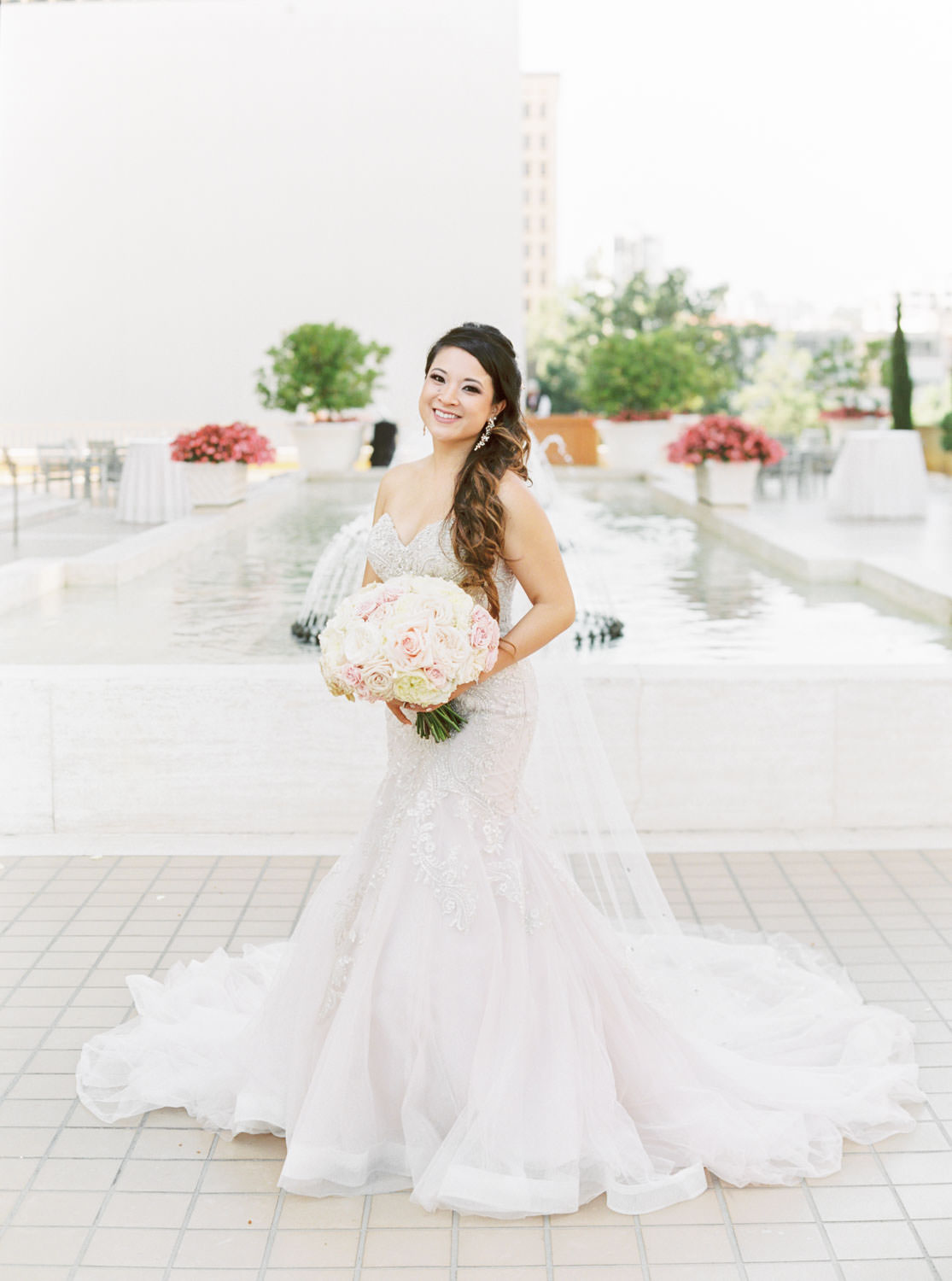 Bridal portrait of a bride in Stella York with blush and ivory bouquet, Westgate Hotel Wedding in Downtown San Diego, film by Cavin Elizabeth Photography