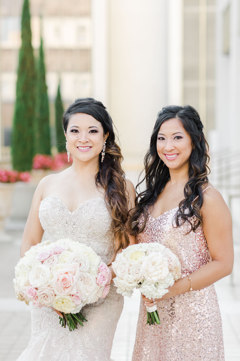 Bridal party portrait of ivory and blush bouquets with bridesmaids in pink blush sequin gowns, Westgate Hotel Wedding in Downtown San Diego, Cavin ELizabeth Photography