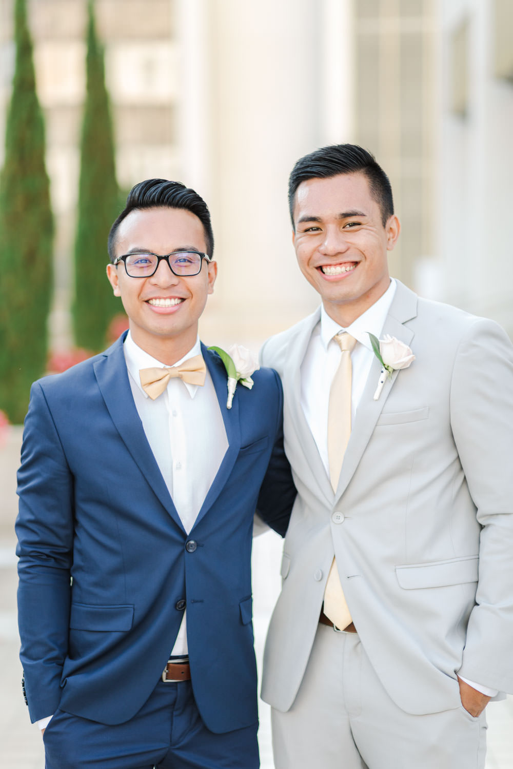Groomsmen in grey suits and groom in navy suit, Cavin Elizabeth Photography