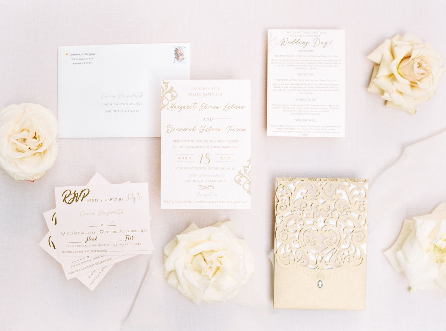 White blush and gold wedding invitation suite with laser cut envelope styled with flowers, film by Cavin ELizabeth Photography