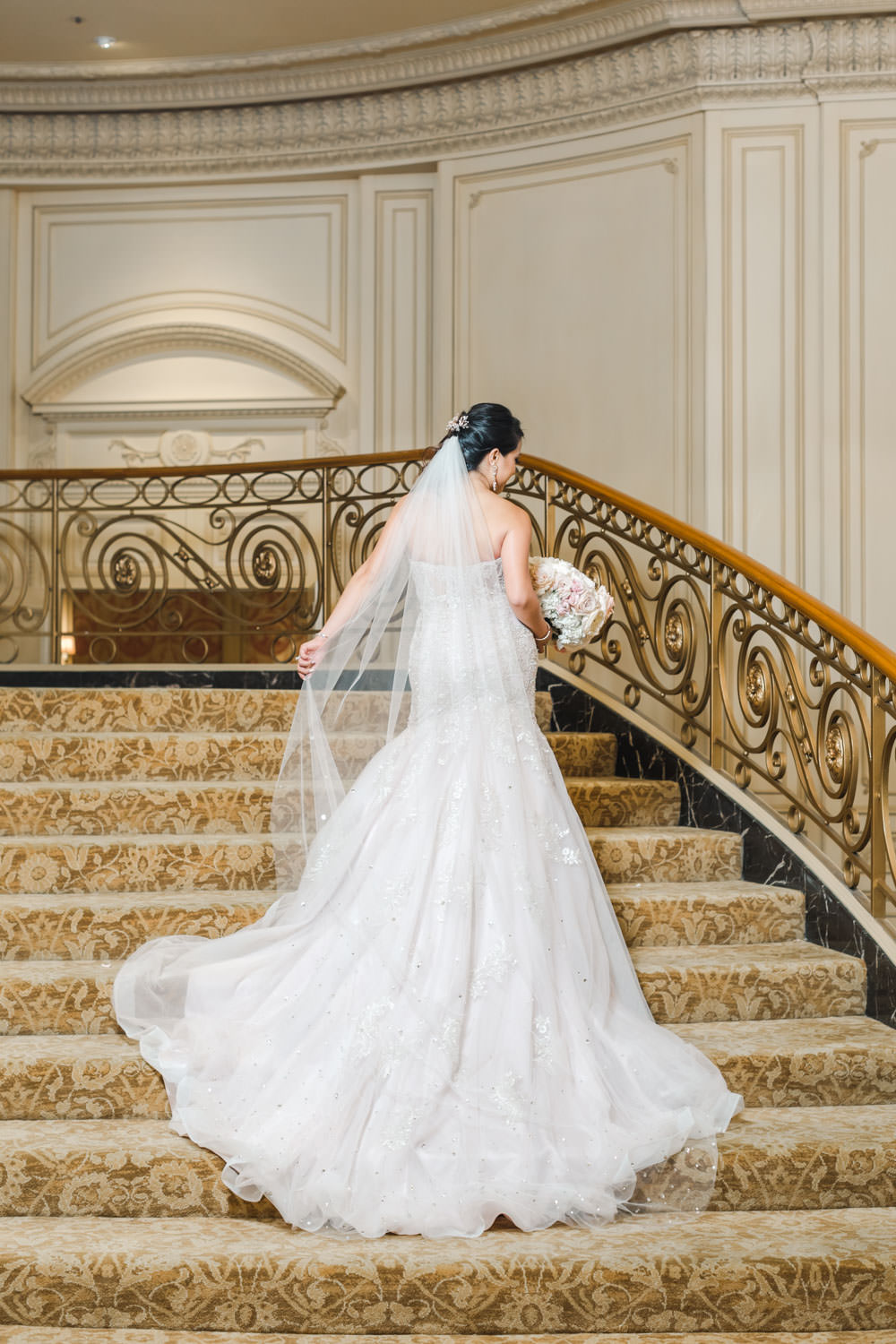 Bridal portrait on staircase for Elegant Westgate Hotel Wedding in Downtown San Diego, Cavin Elizabeth Photography
