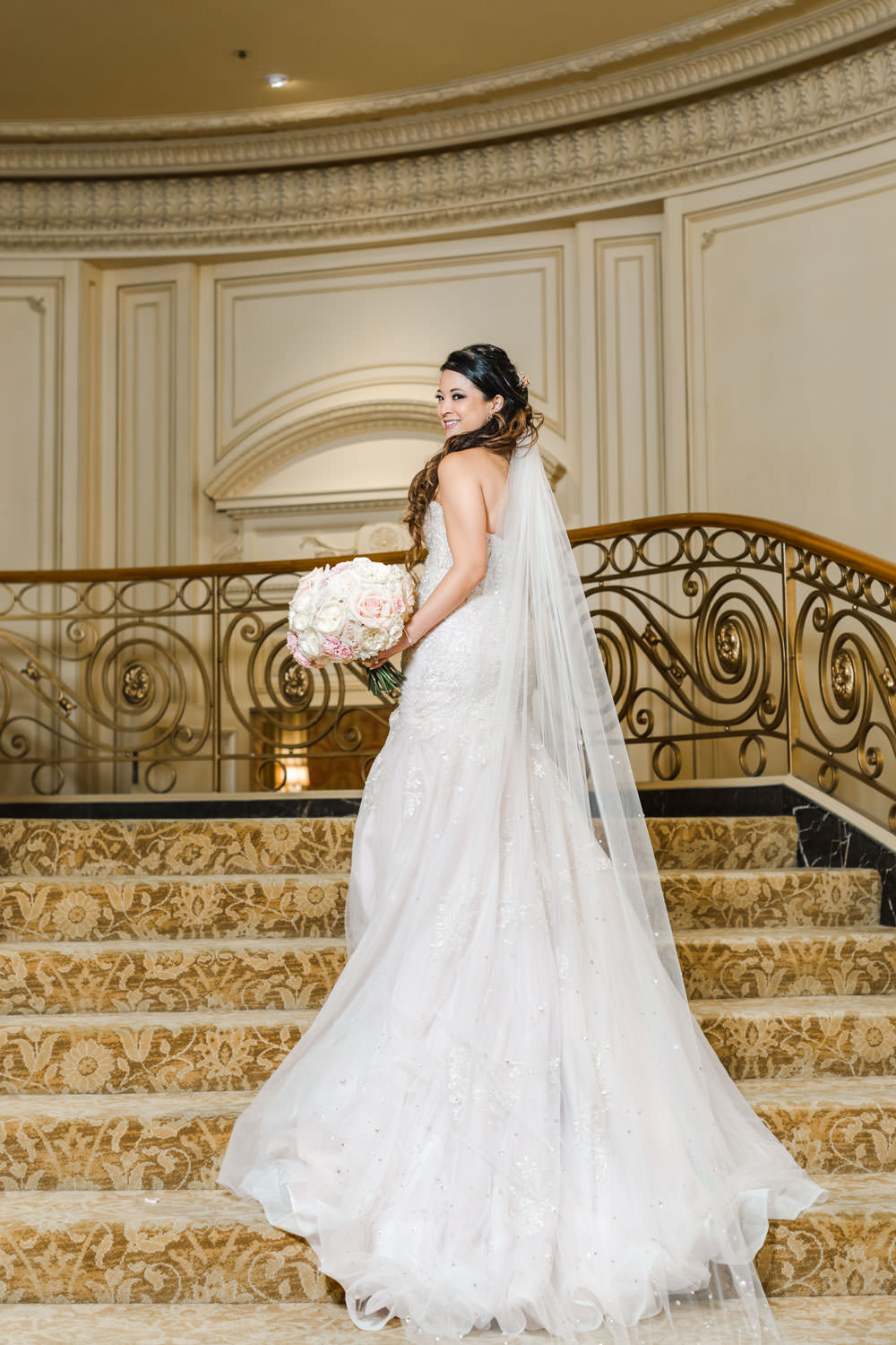 Bridal portrait on staircase at Elegant Westgate Hotel Wedding in Downtown San Diego, Cavin Elizabeth Photography
