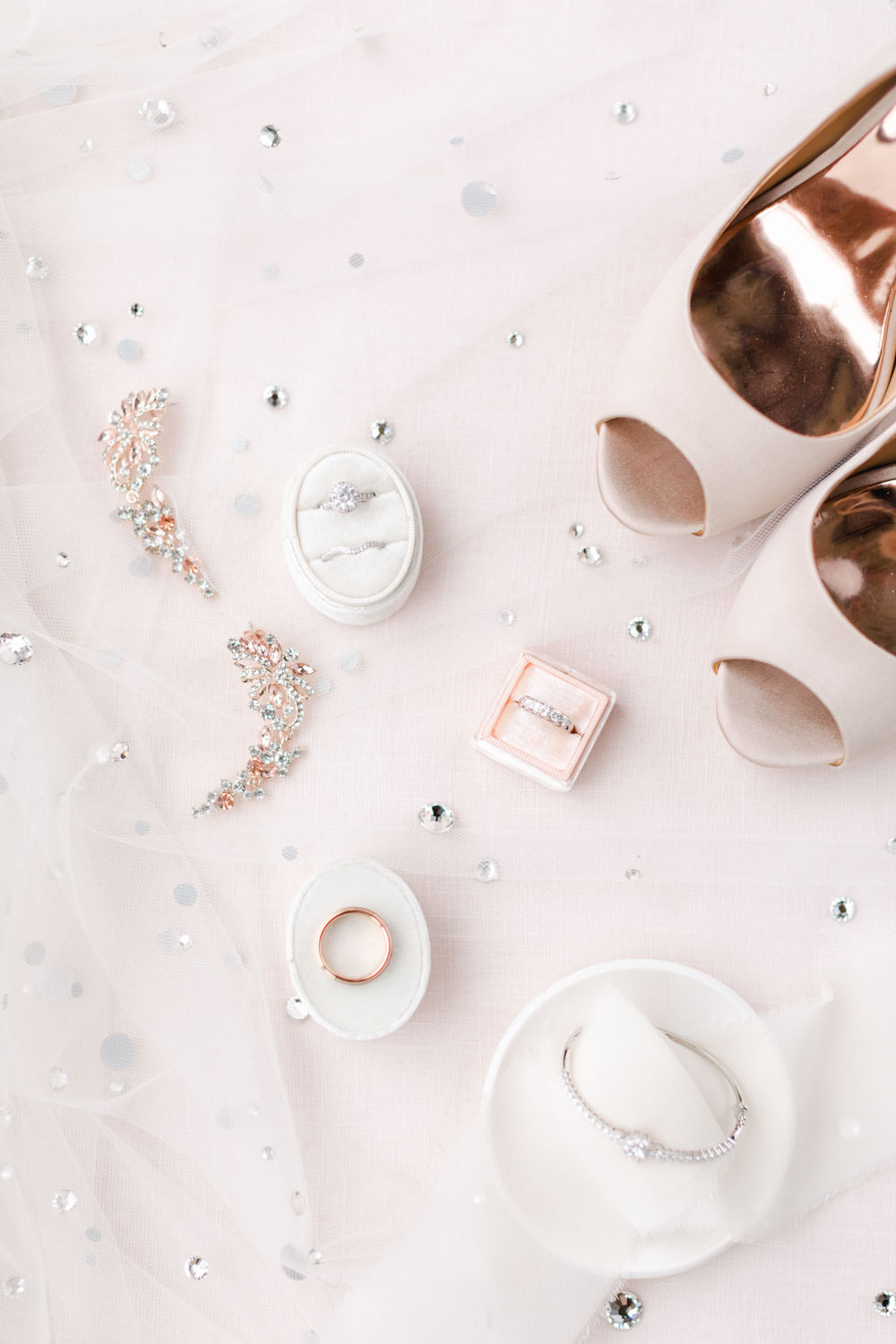 Wedding rings in velvet ring boxes styled on a jewel veil with blush heels and beautiful fine art ring dishes, Cavin Elizabeth Photography