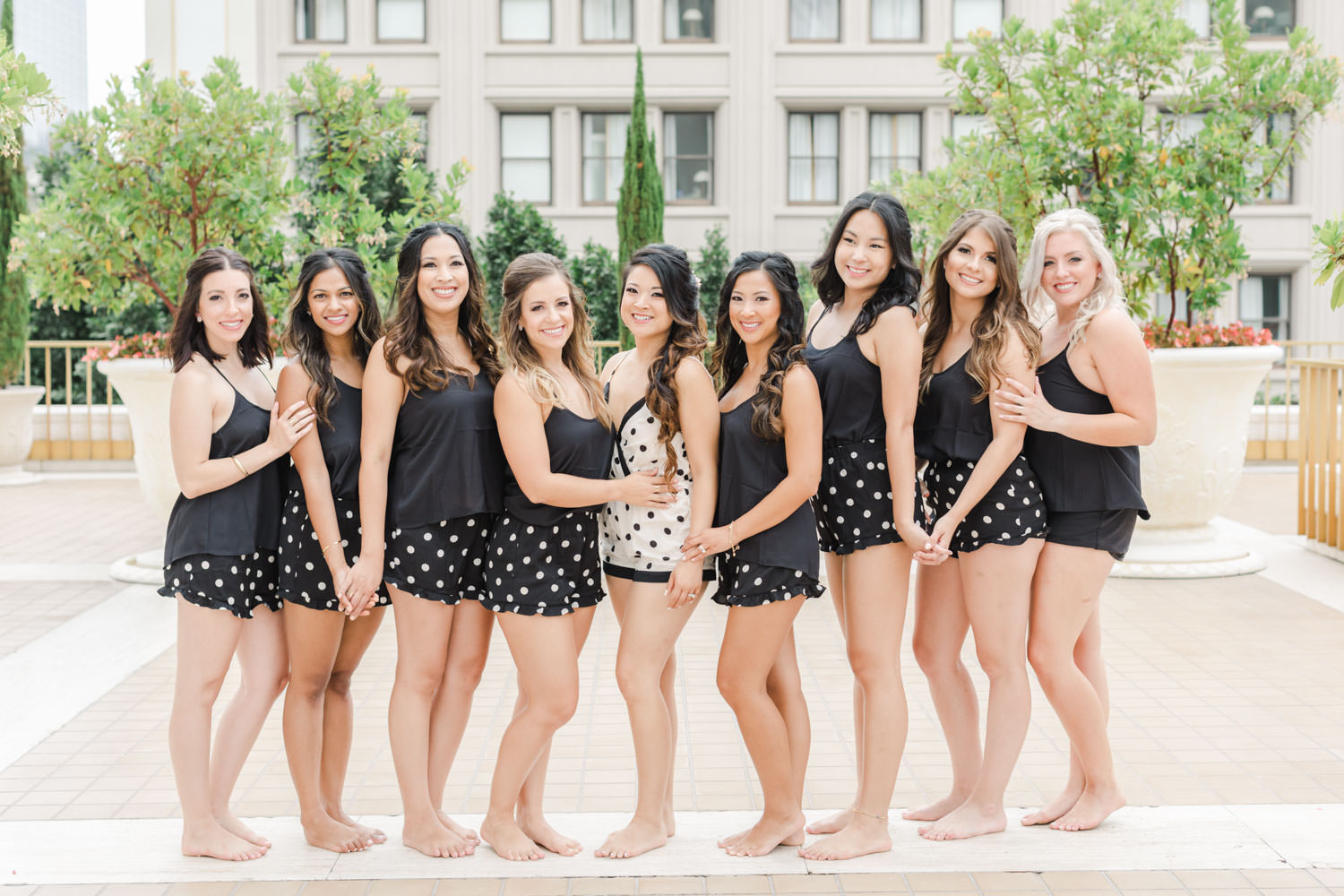 Bride and bridesmaids in pajama tank tops and polka dot shorts, Cavin ELizabeth Photography