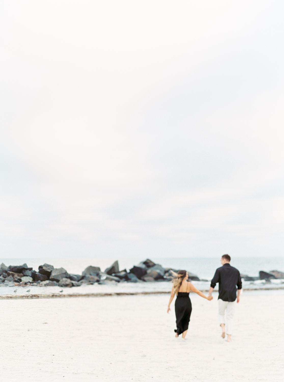 Film photo of couple running on the beach, Romantic Hotel Del Coronado Engagement, Cavin Elizabeth Photography