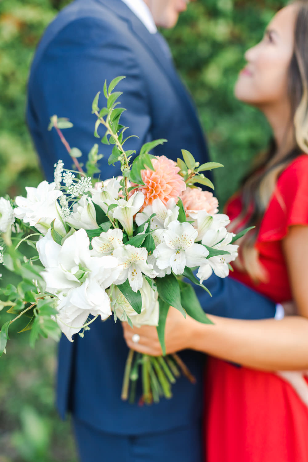 Red dress and navy suit, Formal Coronado Cays Engagement with bouquet, Cavin Elizabeth Photography