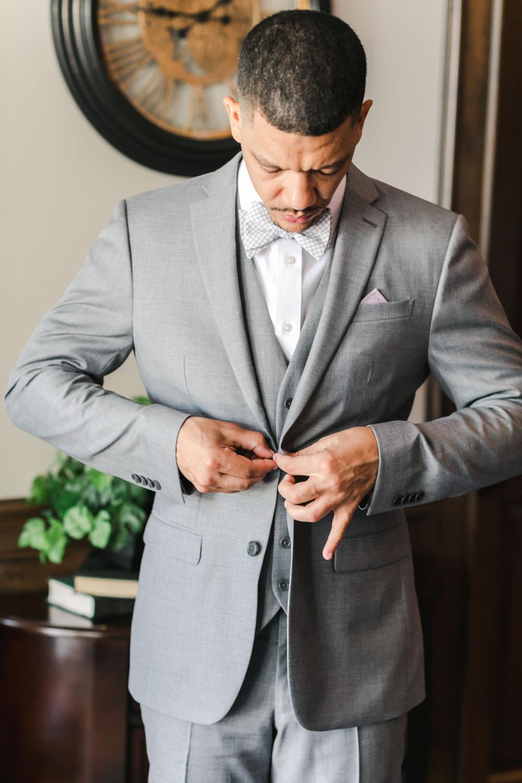 Portrait of groom getting ready in his grey tux, Cavin Elizabeth Photography