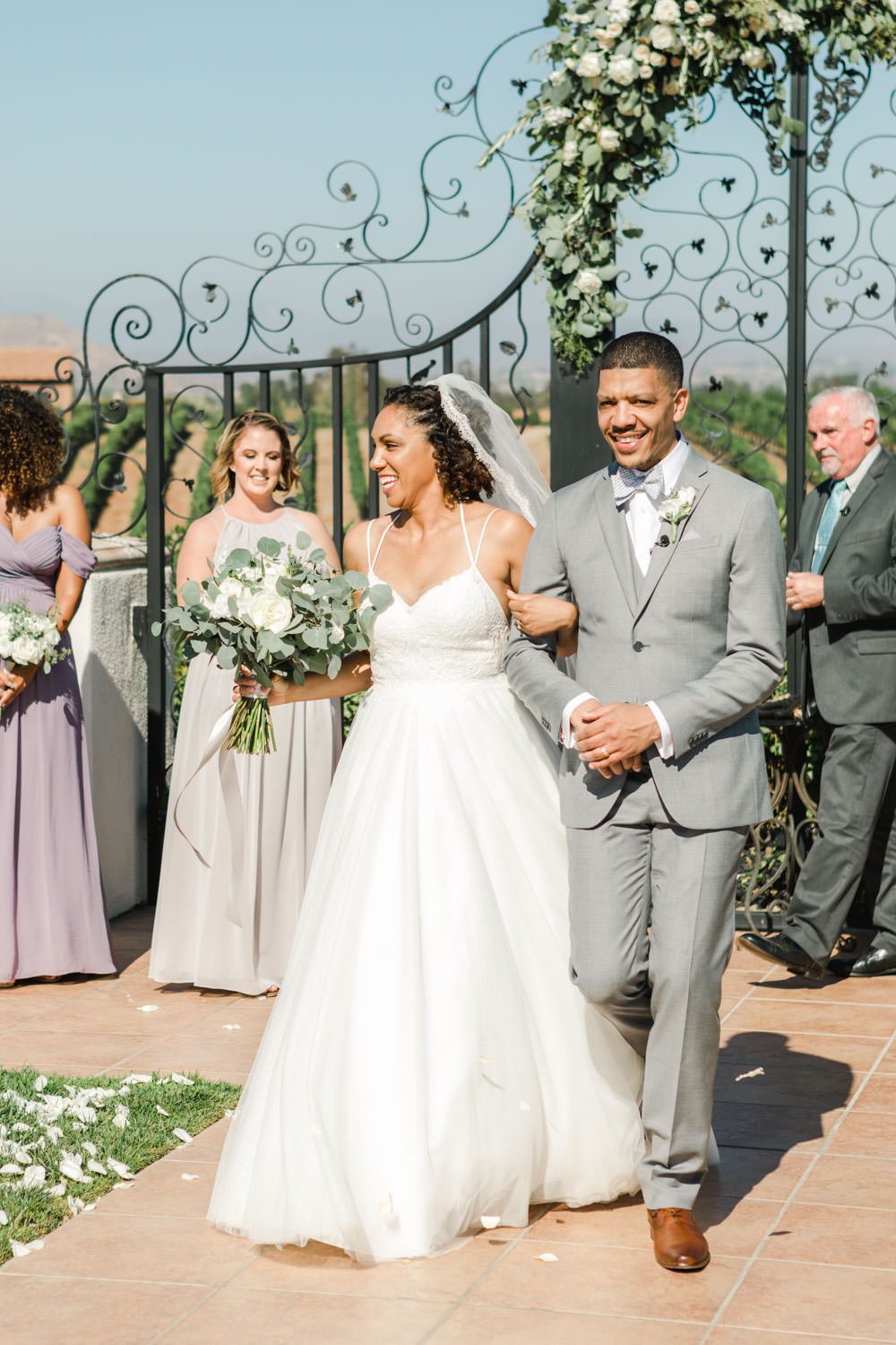 Ceremony with floral covered gate at Temecula Wedding at Villa De Amore, Cavin Elizabeth Photography
