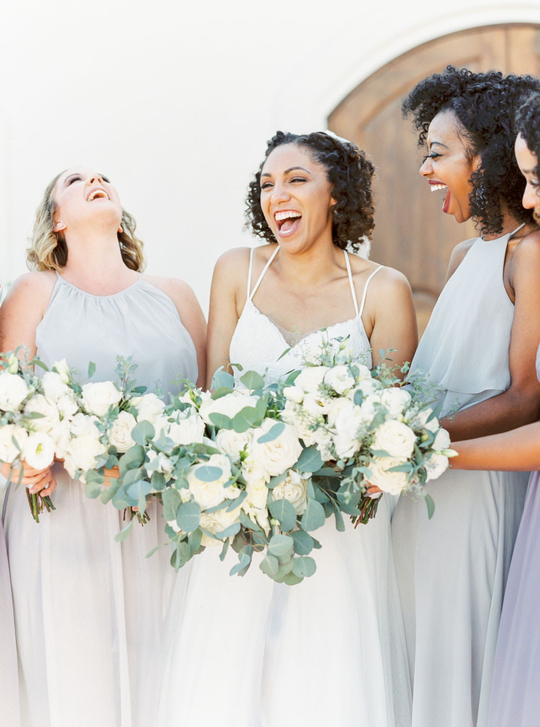 Bridal party film portrait of bridesmaids in grey and lavender dresses with white and green flowers at Temecula Wedding at Villa De Amore, Cavin Elizabeth Photography