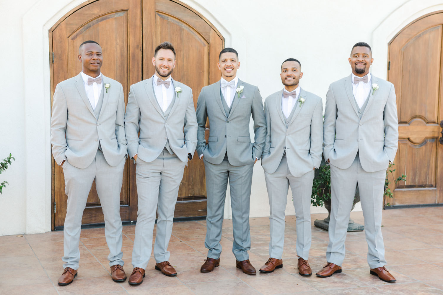 Groomsmen portrait in grey suits with white and green boutonnieres at Temecula Wedding at Villa De Amore, Cavin Elizabeth Photography