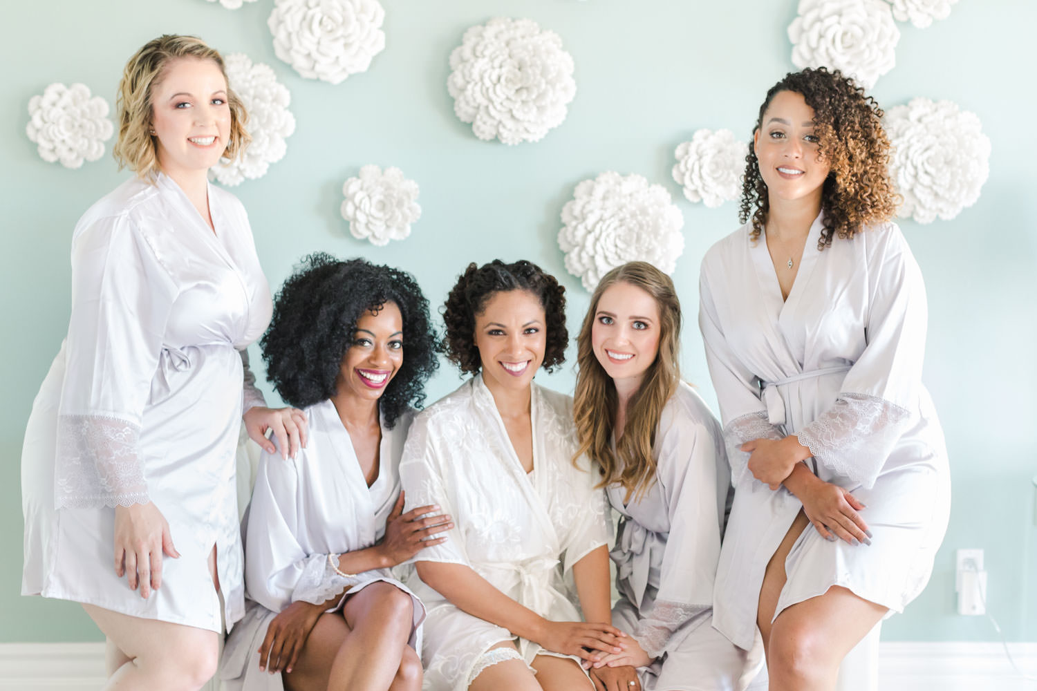 Bridesmaids in robes sitting together during getting ready, Cavin Elizabeth Photography