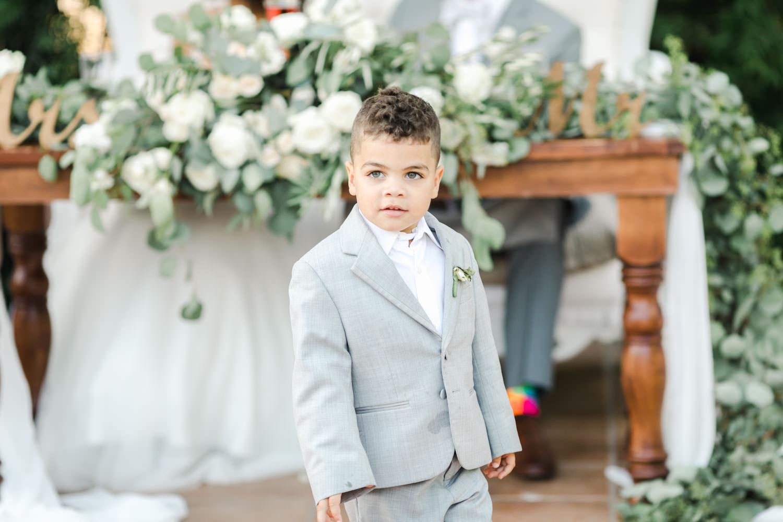 Bride and groom's adorable ring bearer son at Temecula Wedding at Villa De Amore, Cavin Elizabeth Photography