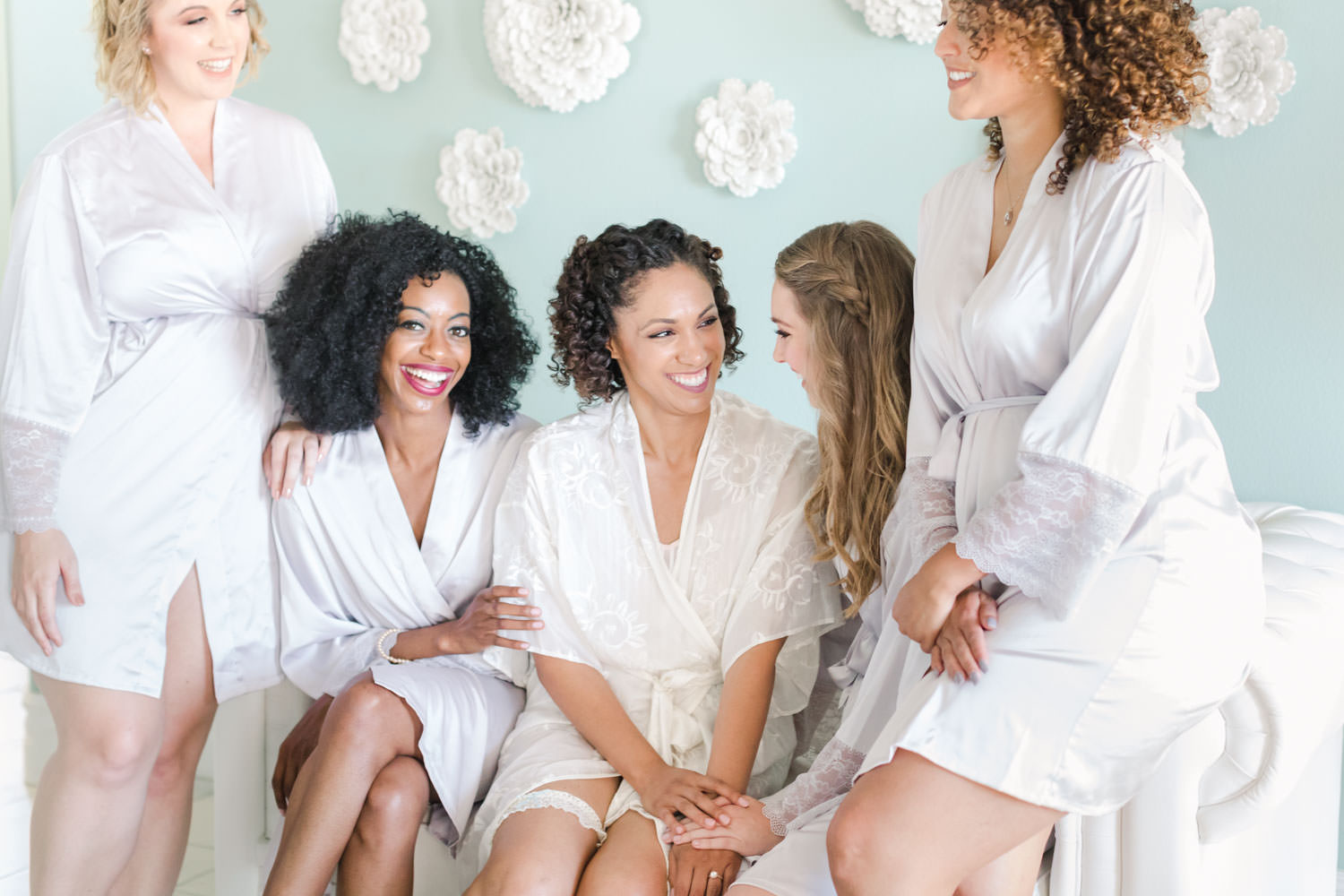 Bridesmaids in robes laughing together during getting ready, Cavin Elizabeth Photography