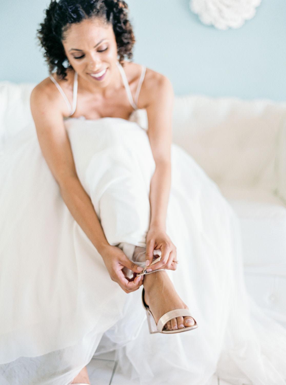 Film portrait of a bride getting into her wedding shoes, Cavin Elizabeth Photography