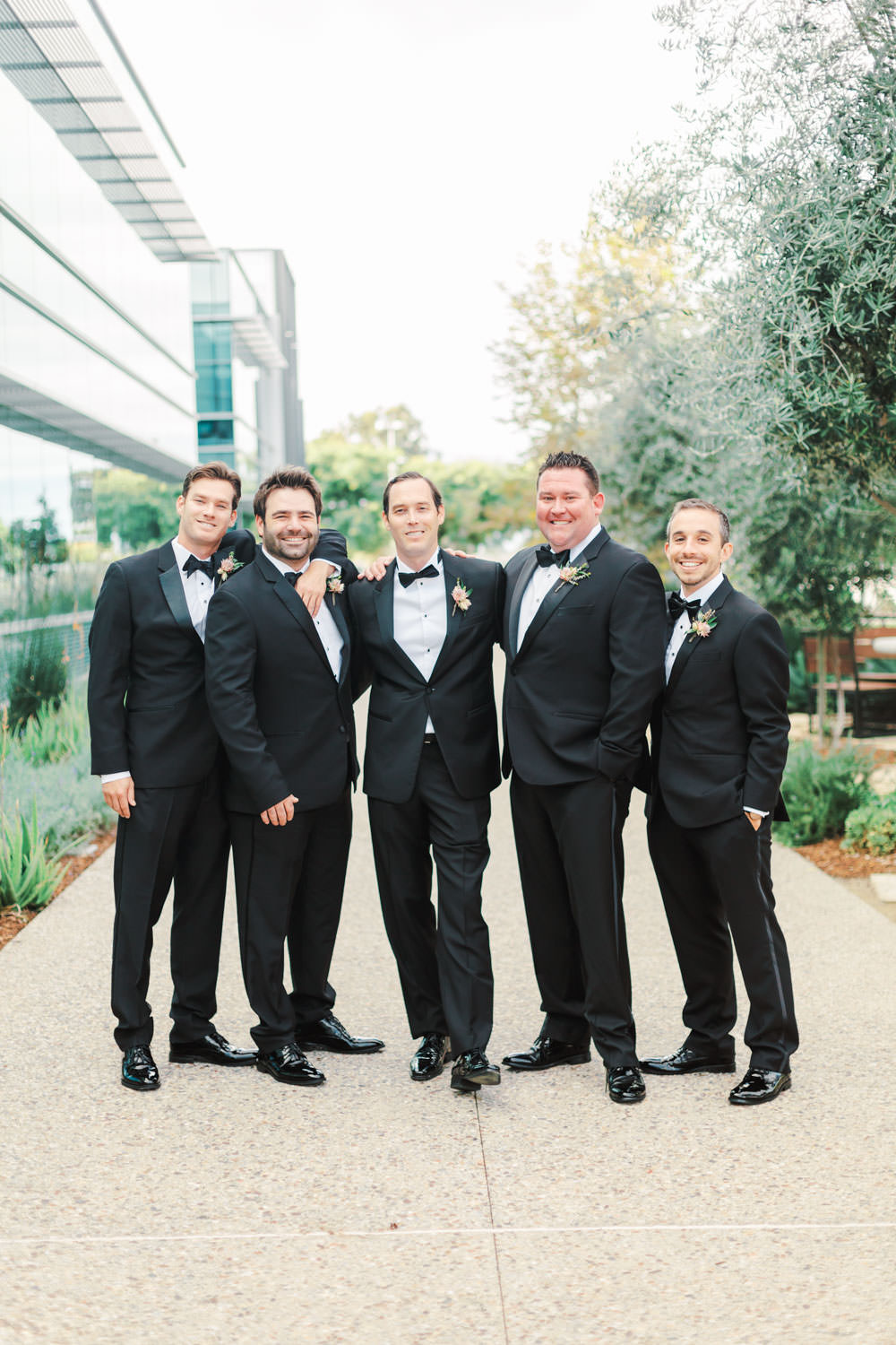 Groom and groomsmen in black tuxes at Green Acre Campus Pointe wedding, Cavin Elizabeth Photography