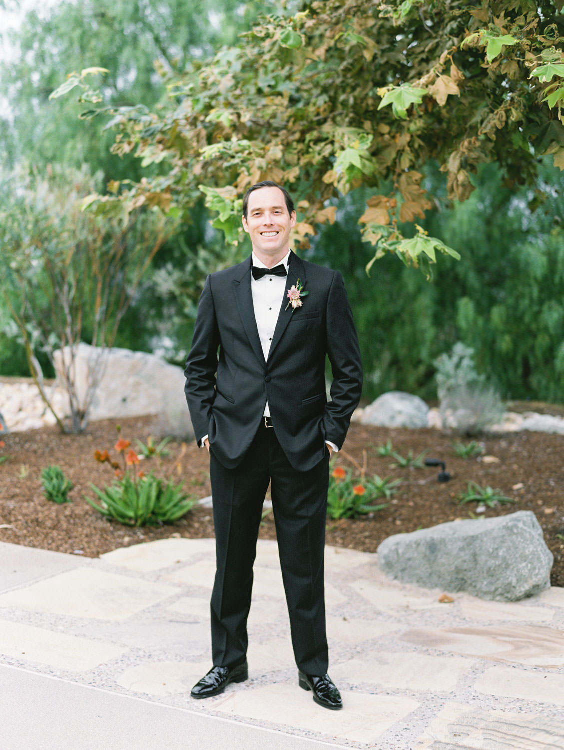 Groom in black tux at Green Acre Campus Pointe Wedding, film photo by Cavin Elizabeth Photography