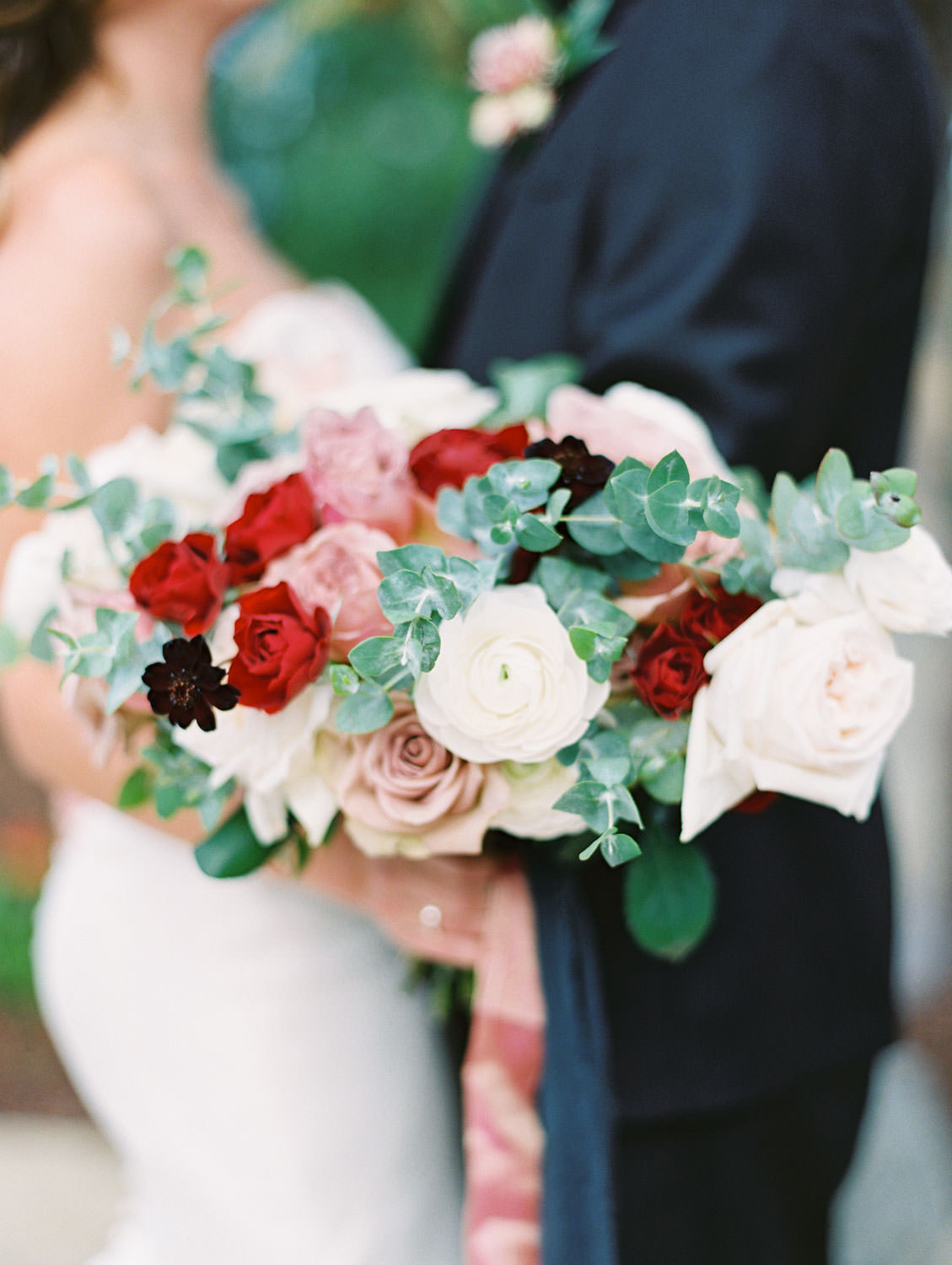 Bride in Anne Barge sweetheart gown with red ivory and mauve bouquet and groom in black tux at Green Acre Campus Pointe Wedding, film photo by Cavin Elizabeth Photography
