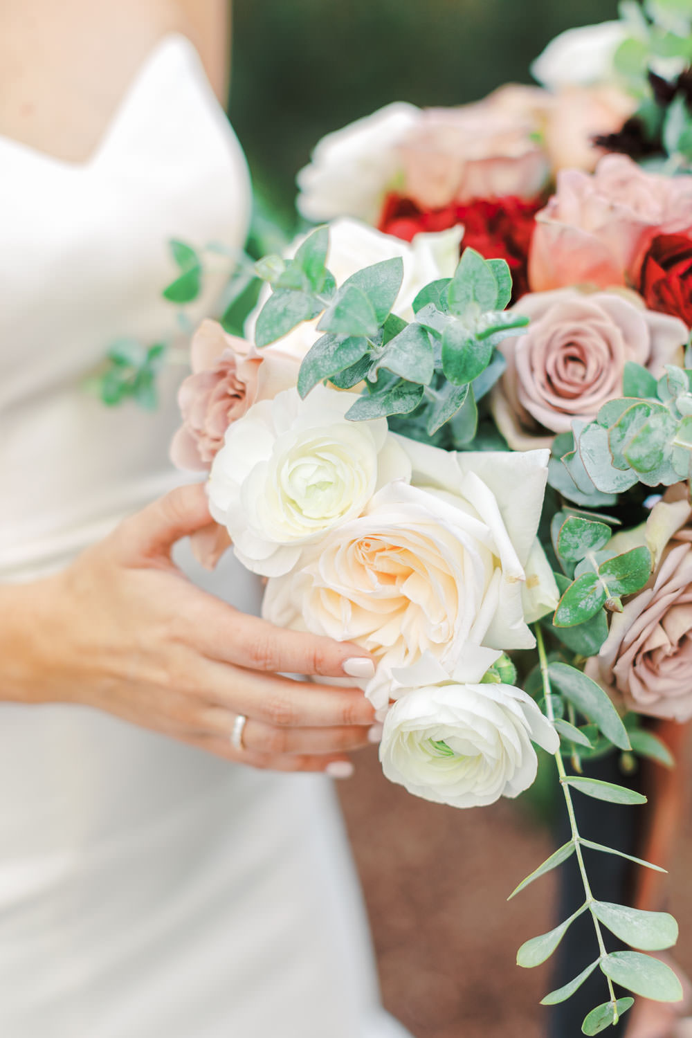 Bride in Anne Barge sweetheart gown with red ivory and mauve bouquet at Green Acre Campus Pointe Wedding, photo by Cavin Elizabeth Photography
