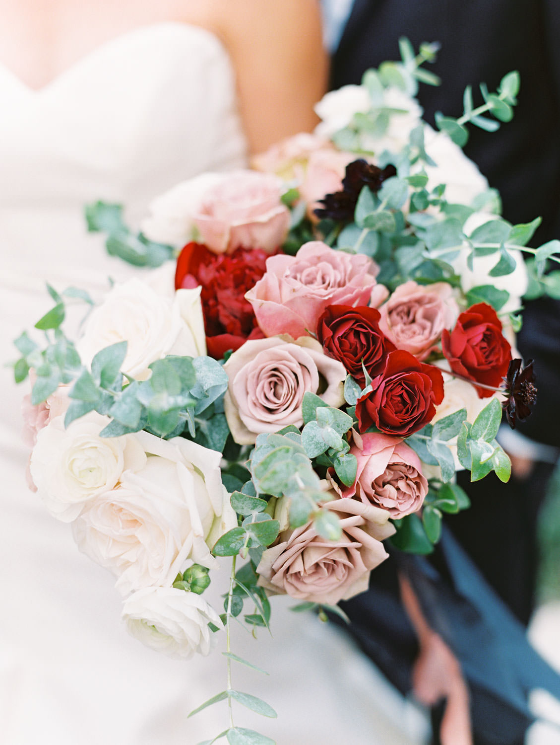 Bride in Anne Barge sweetheart gown with red ivory and mauve bouquet at Green Acre Campus Pointe Wedding, film photo by Cavin Elizabeth Photography
