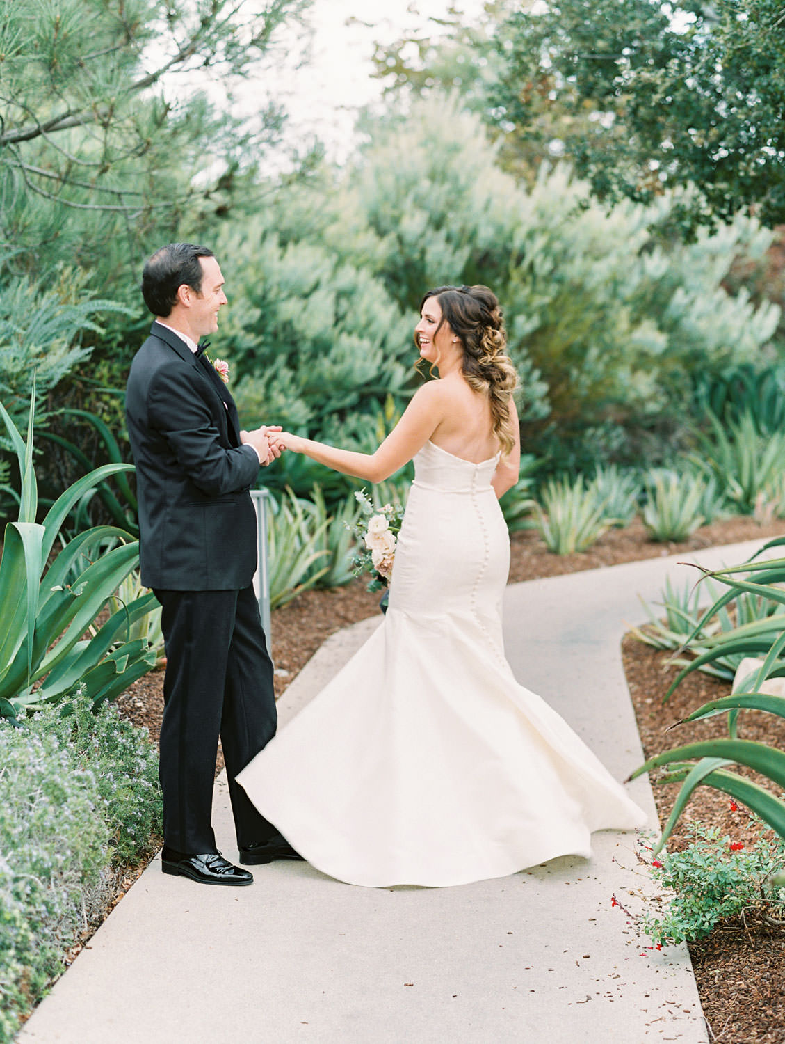 Bride in Anne Barge sweetheart gown dancing with groom in black tux at Green Acre Campus Pointe Wedding, film photo by Cavin Elizabeth Photography