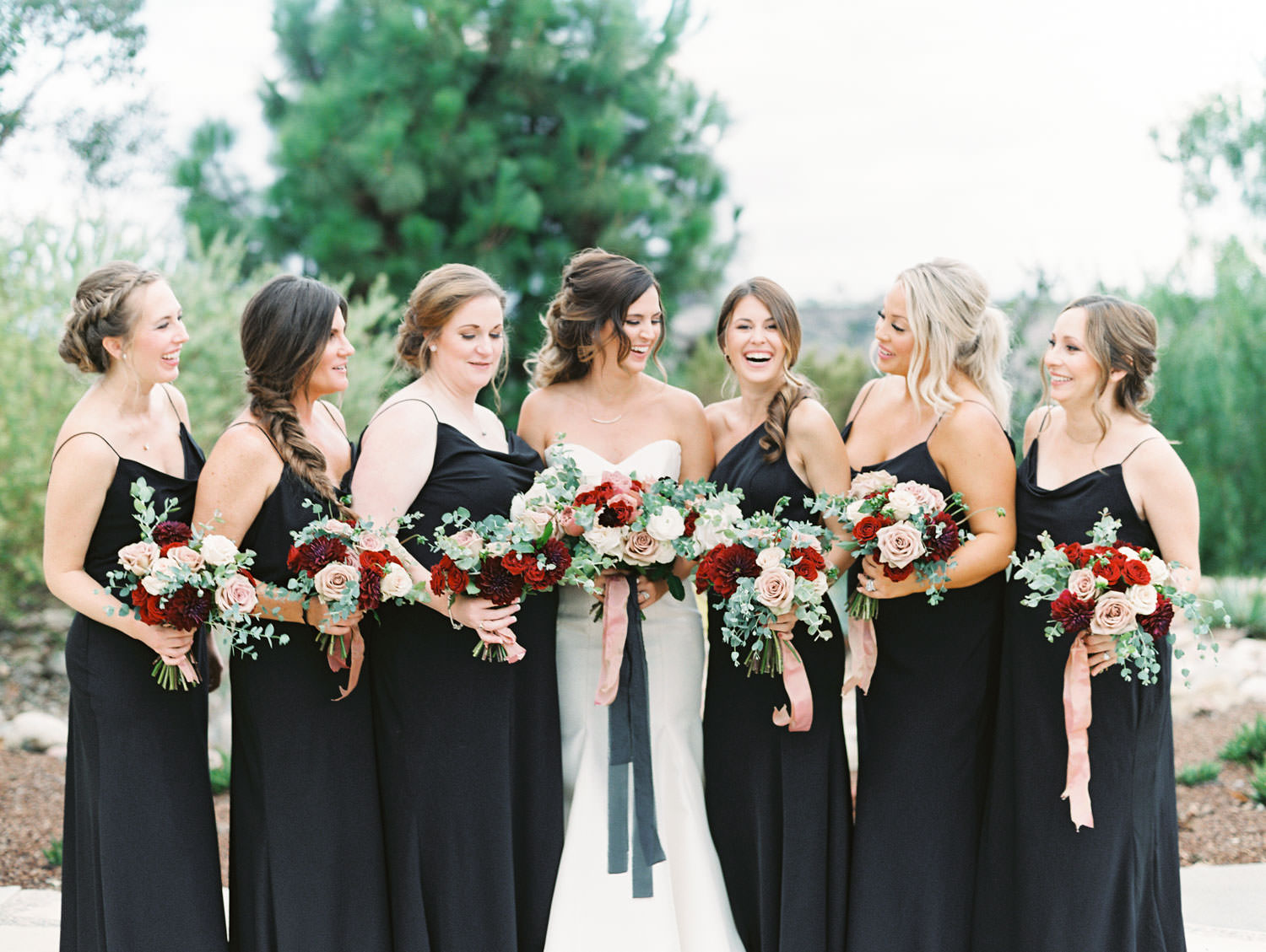 Bride in Anne Barge sweetheart gown with red ivory and mauve bouquet and bridesmaids in black dresses at Green Acre Campus Pointe Wedding, film photo by Cavin Elizabeth Photography