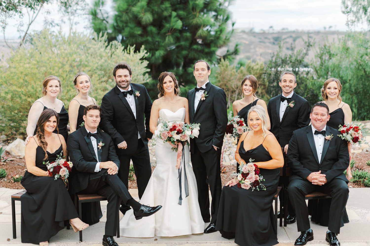 Bride in Anne Barge sweetheart gown with red ivory and mauve bouquet and bridesmaids in black dresses with groomsmen in black tuxes at Green Acre Campus Pointe Wedding, photo by Cavin Elizabeth Photography