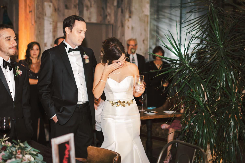 Bride reacting to toast at Green Acre Campus Pointe Wedding San Diego, Cavin Elizabeth Photography