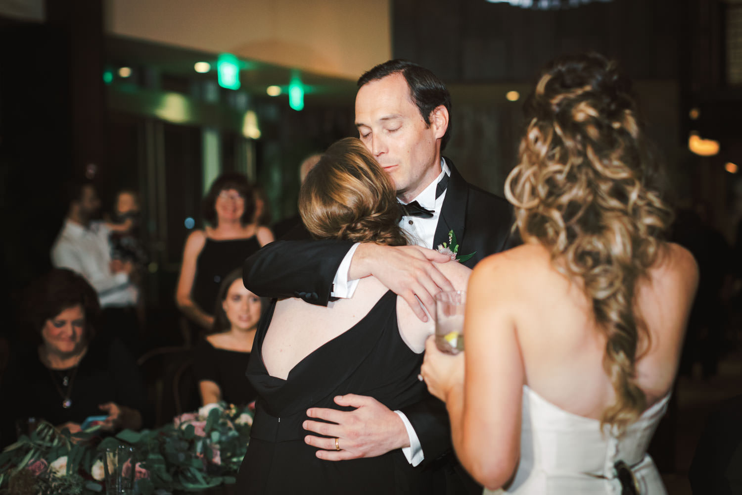 Groom hugging toaster maid of honor at Green Acre Campus Pointe Wedding San Diego, Cavin Elizabeth Photography