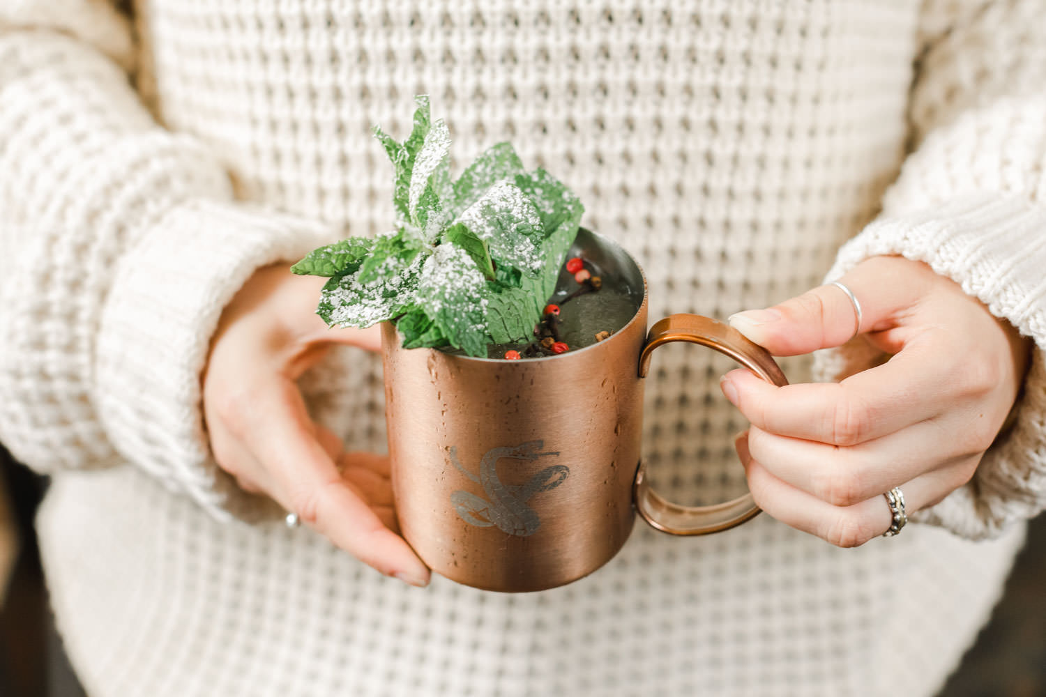 Holding winter cocktail in copper mug with mint and berry garnish, Snake Oil Cocktail's Fall Wedding Cocktails, Cavin Elizabeth Photography
