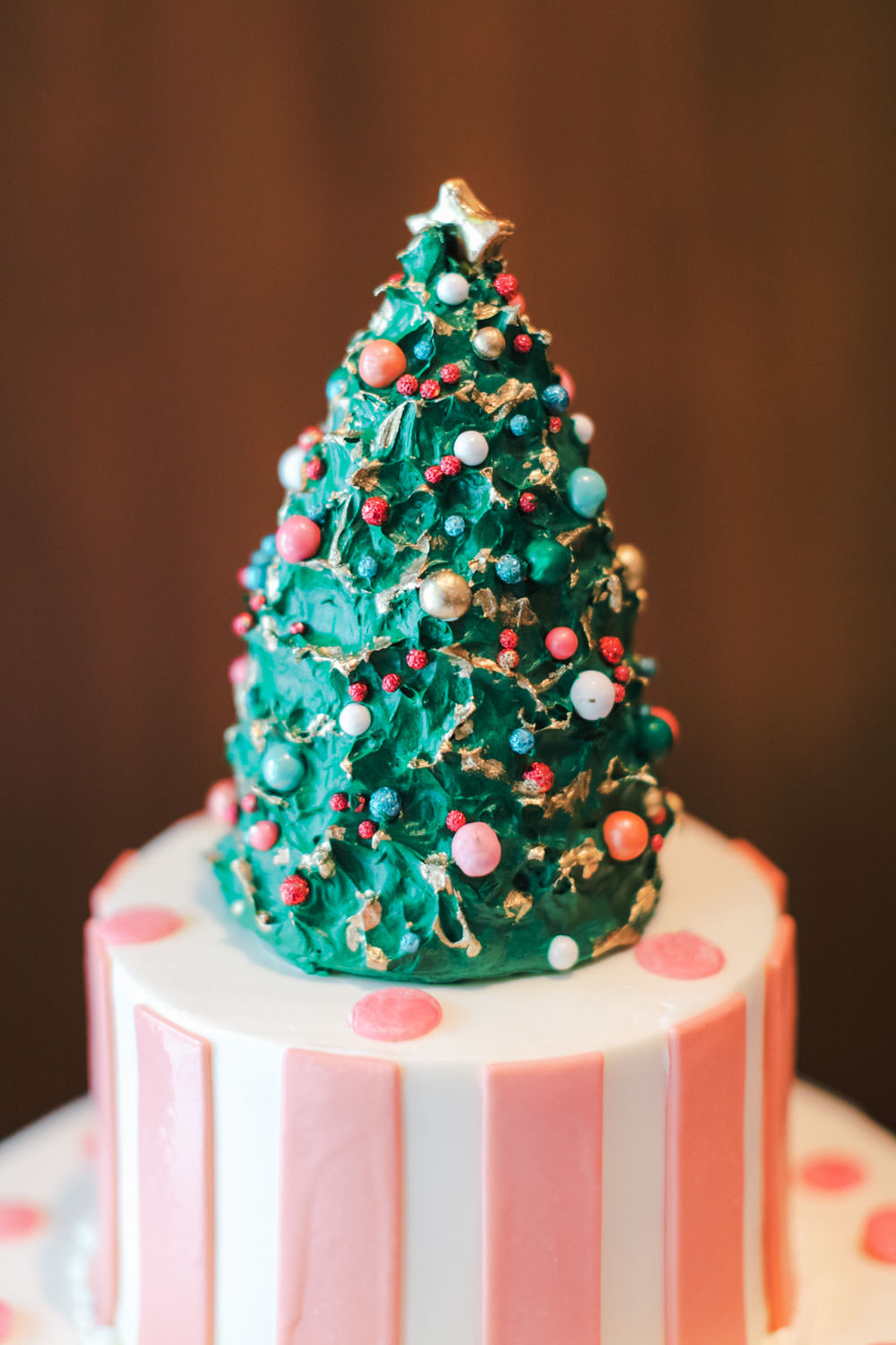 Tropical Christmas bridal shower cake with pink and white stripes and palm tree print with Christmas tree topper, Cavin Elizabeth Photography