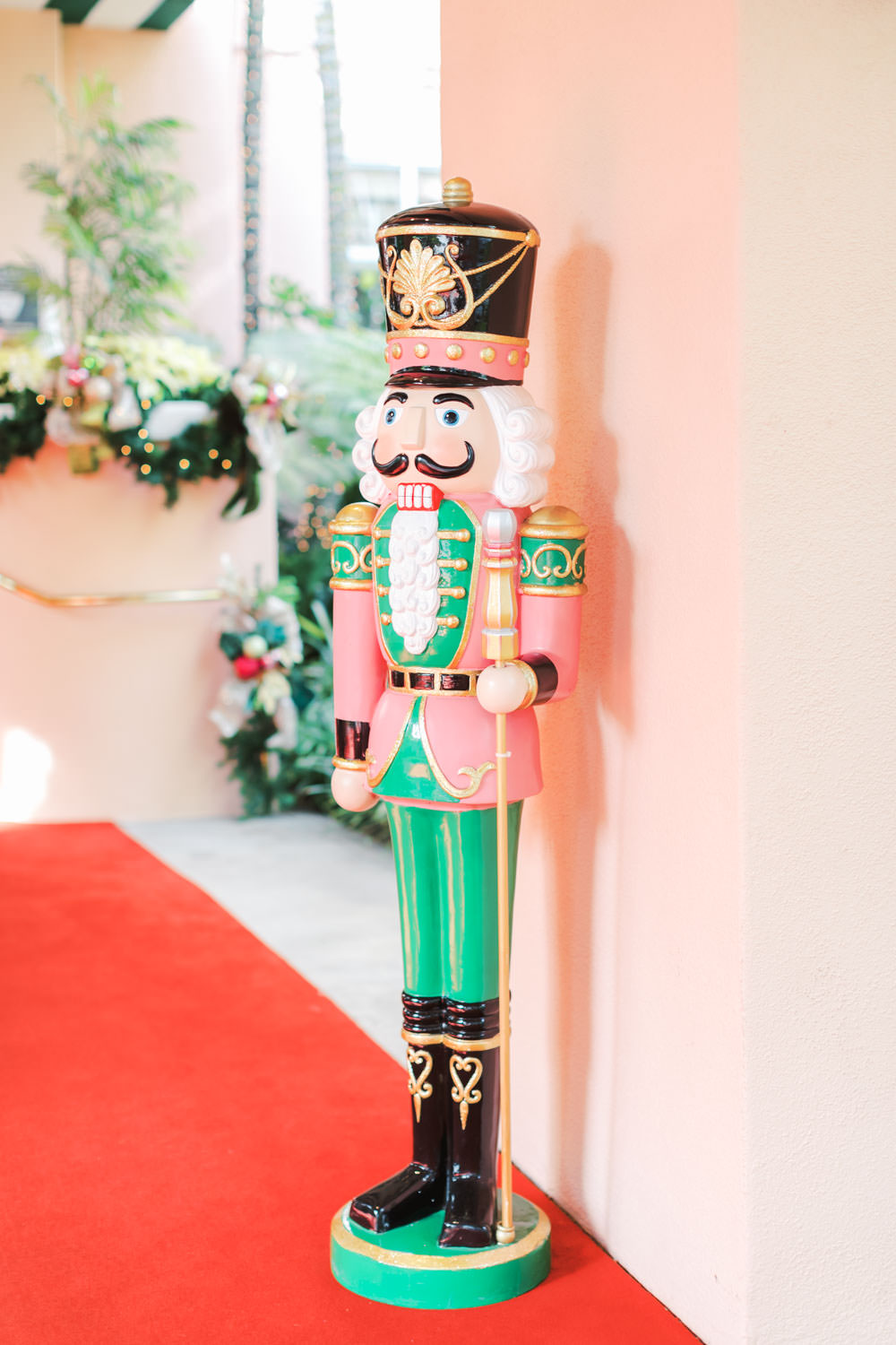 Chic Beverly Hills Hotel nutcracker statue with pink and teal in Los Angeles during Christmas decorations, Cavin Elizabeth Photography