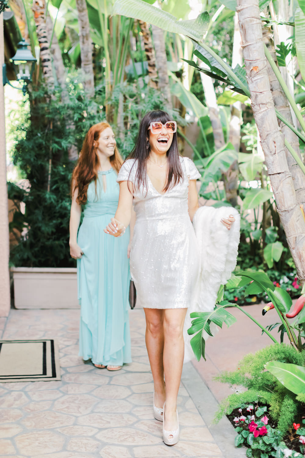 Bride wearing white sparkly sequin dress and white fur shawl with white handbag at Chic Beverly Hills Hotel Bridal Shower during Christmas decorations, Cavin Elizabeth Photography