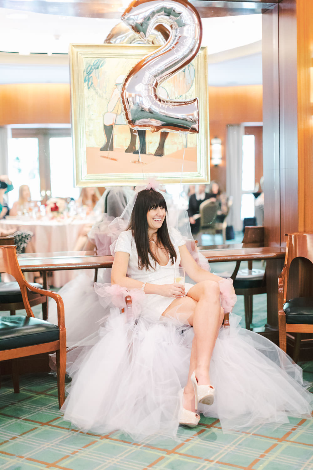 Bride in tulle chair at Chic Beverly Hills Hotel Bridal Shower during Christmas time, Cavin Elizabeth Photography