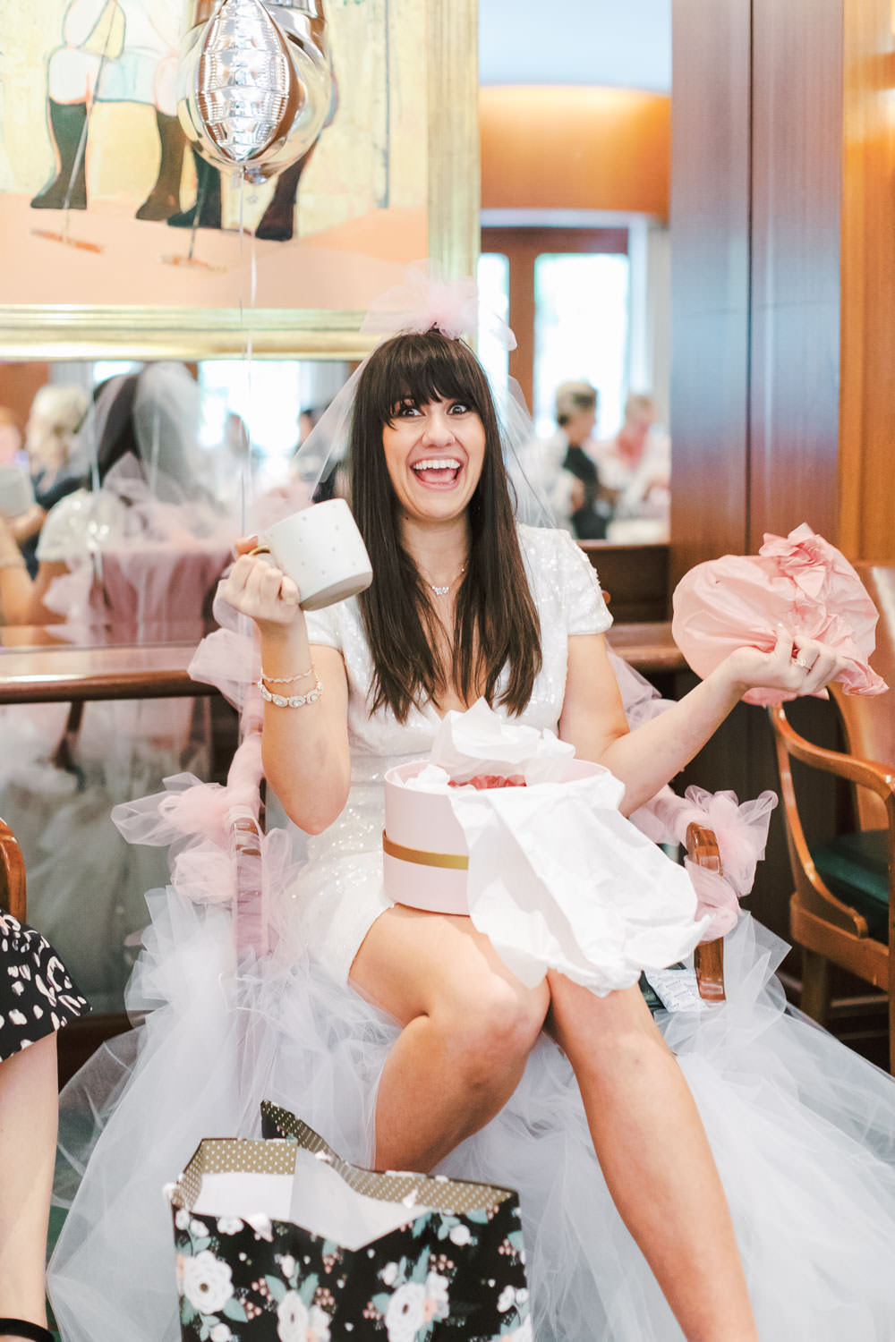 Bride opening gifts, Chic Beverly Hills Hotel Bridal Shower during Christmas time, Cavin Elizabeth Photography