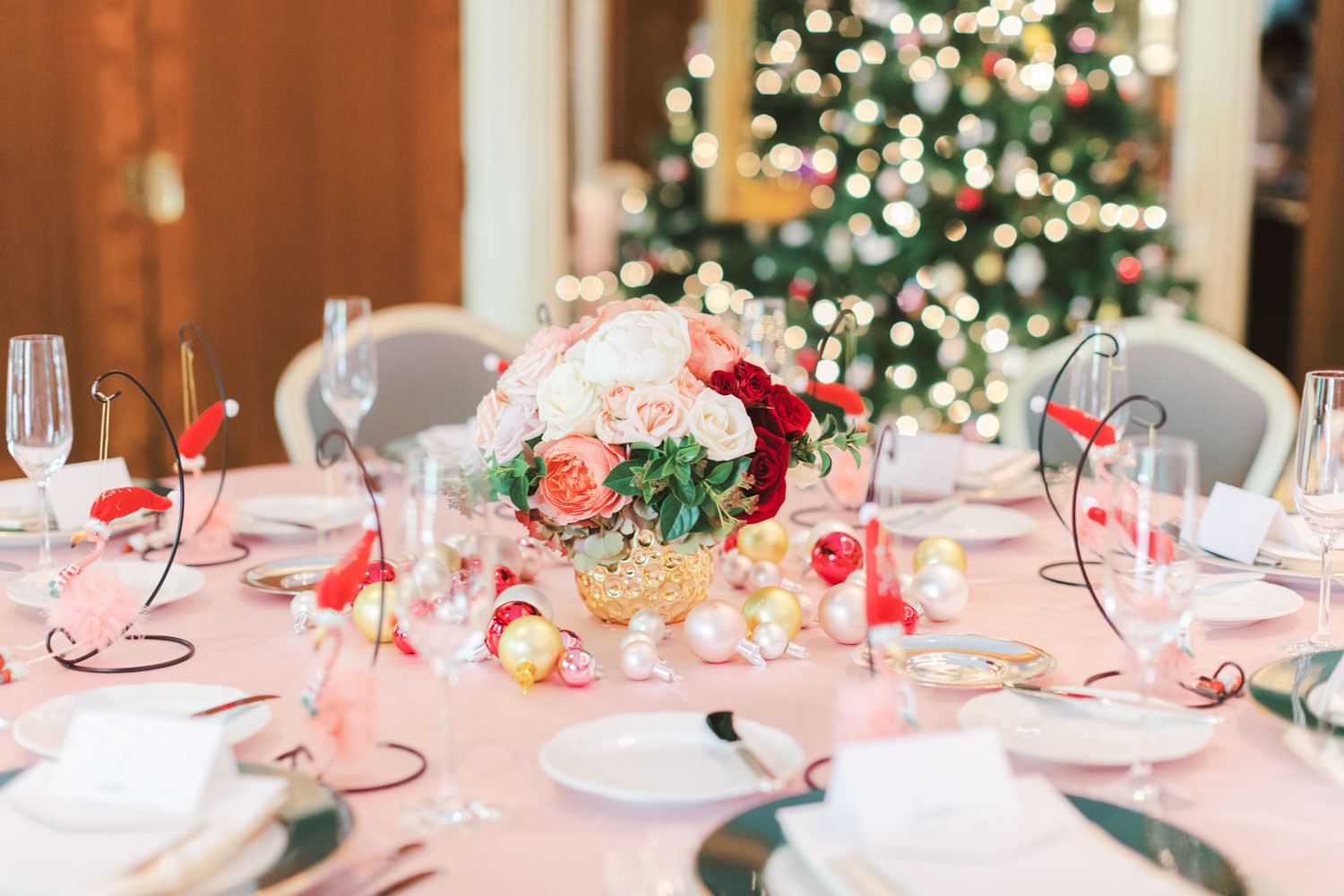 Chic Beverly Hills Hotel Bridal Shower table with pink linens and pops of ivory and red in Los Angeles during Christmas decorations, Cavin Elizabeth Photography