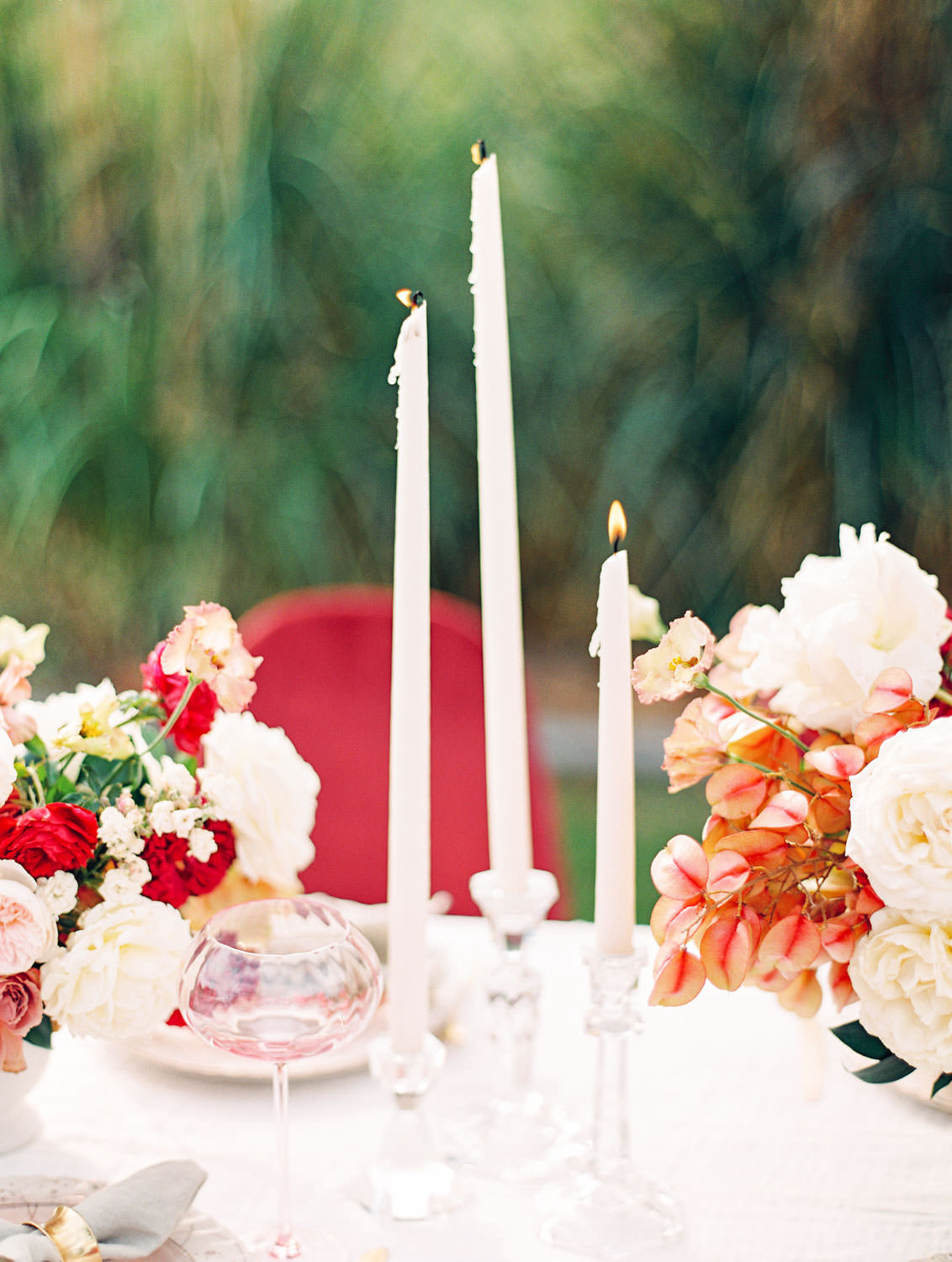 Taper candles on White linen with burgundy velvet chairs and centerpieces with ivory blush red and neutral tones, Pampas Grass Wedding in San Diego on Film by Cavin Elizabeth Photography