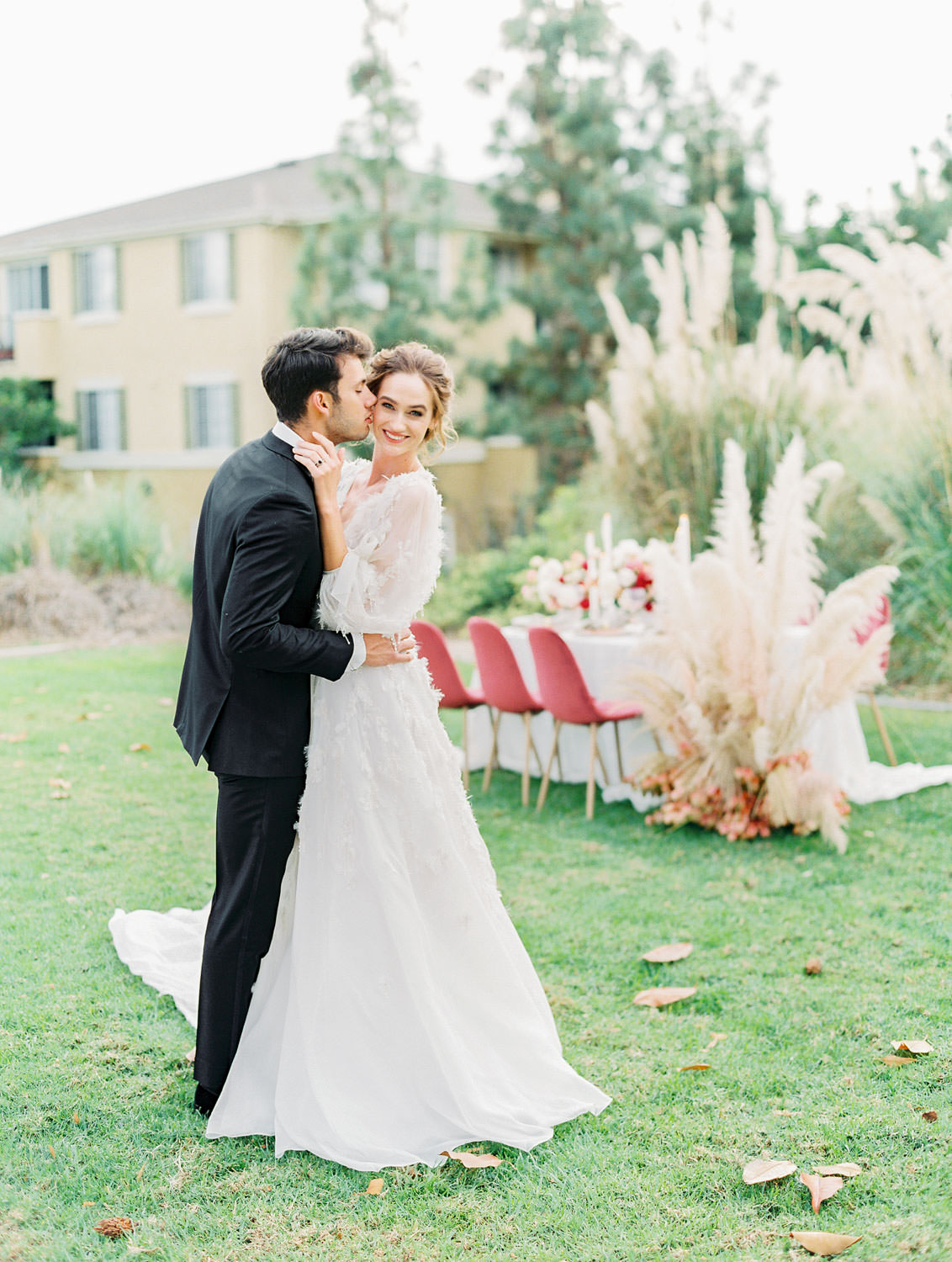 Bride in long sleeve Marchesa Poppy gown and groom in The Black Tux in a pampas grove, Pampas Grass Wedding in San Diego on Film by Cavin Elizabeth Photography
