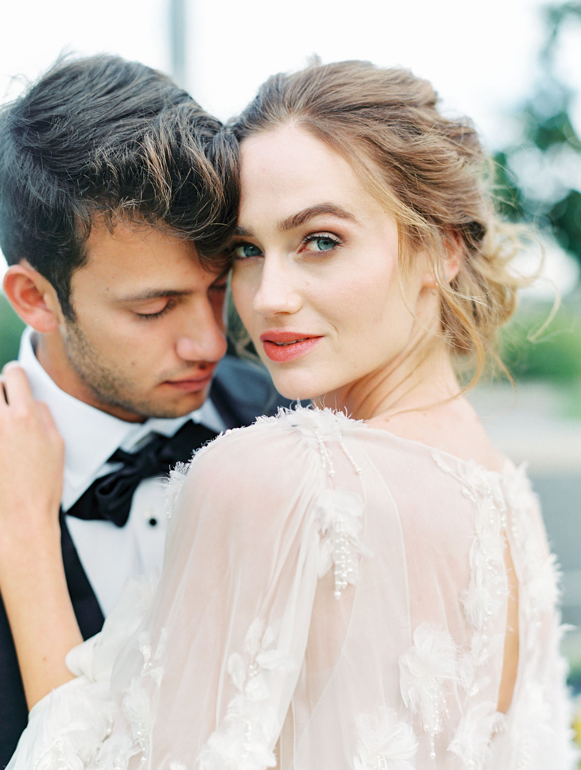 Close up portrait of bride in long sleeve Marchesa Poppy gown and groom in The Black Tux in a pampas grove, Pampas Grass Wedding in San Diego on Film by Cavin Elizabeth Photography