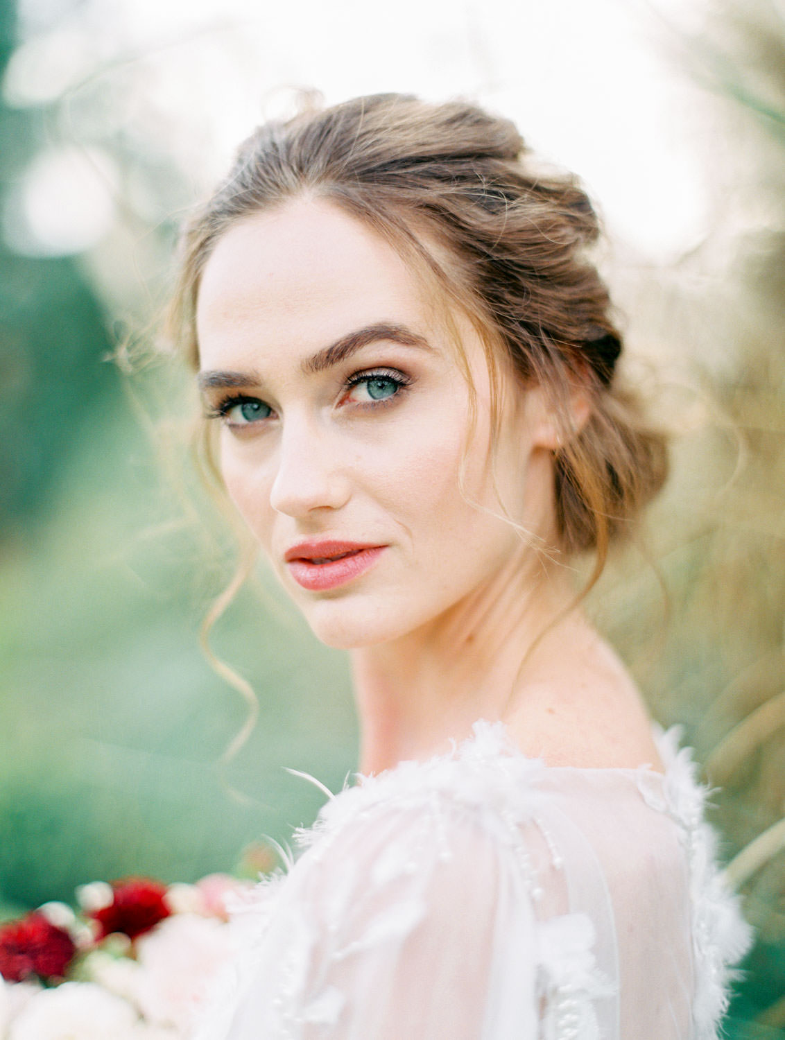 Bride with burgundy blush and ivory bouquet in long sleeve Marchesa Poppy gown, beaded and feather embellished wedding dress, Pampas Grass Wedding in San Diego on Film by Cavin Elizabeth Photography