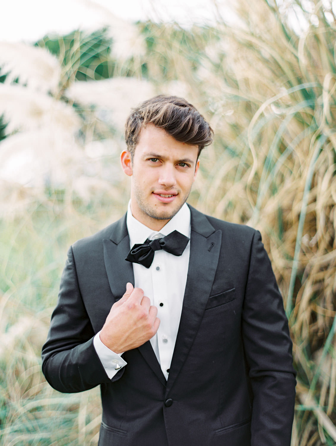 Groom wearing the Black Tux, Pampas Grass Wedding in San Diego on Film by Cavin Elizabeth Photography