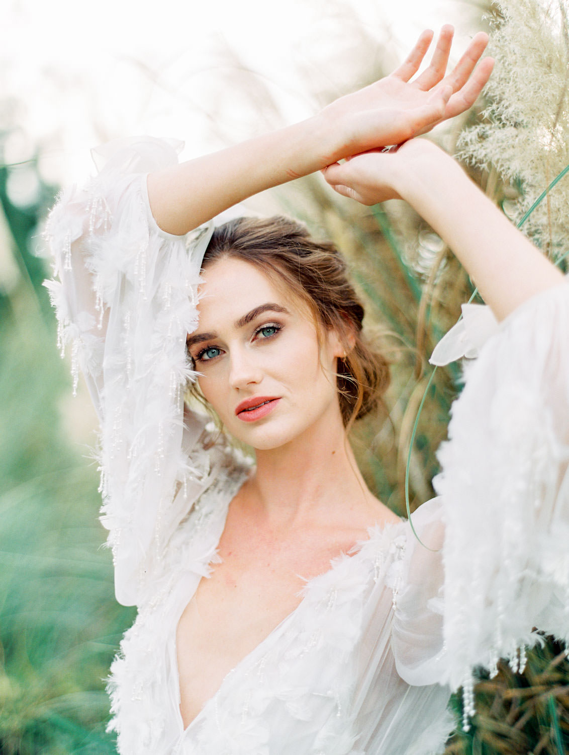 Bride wearing long sleeve Marchesa Poppy gown, beaded and feather embellished wedding dress and ruby David Yurman ring, Pampas Grass Wedding in San Diego on Film by Cavin Elizabeth Photography