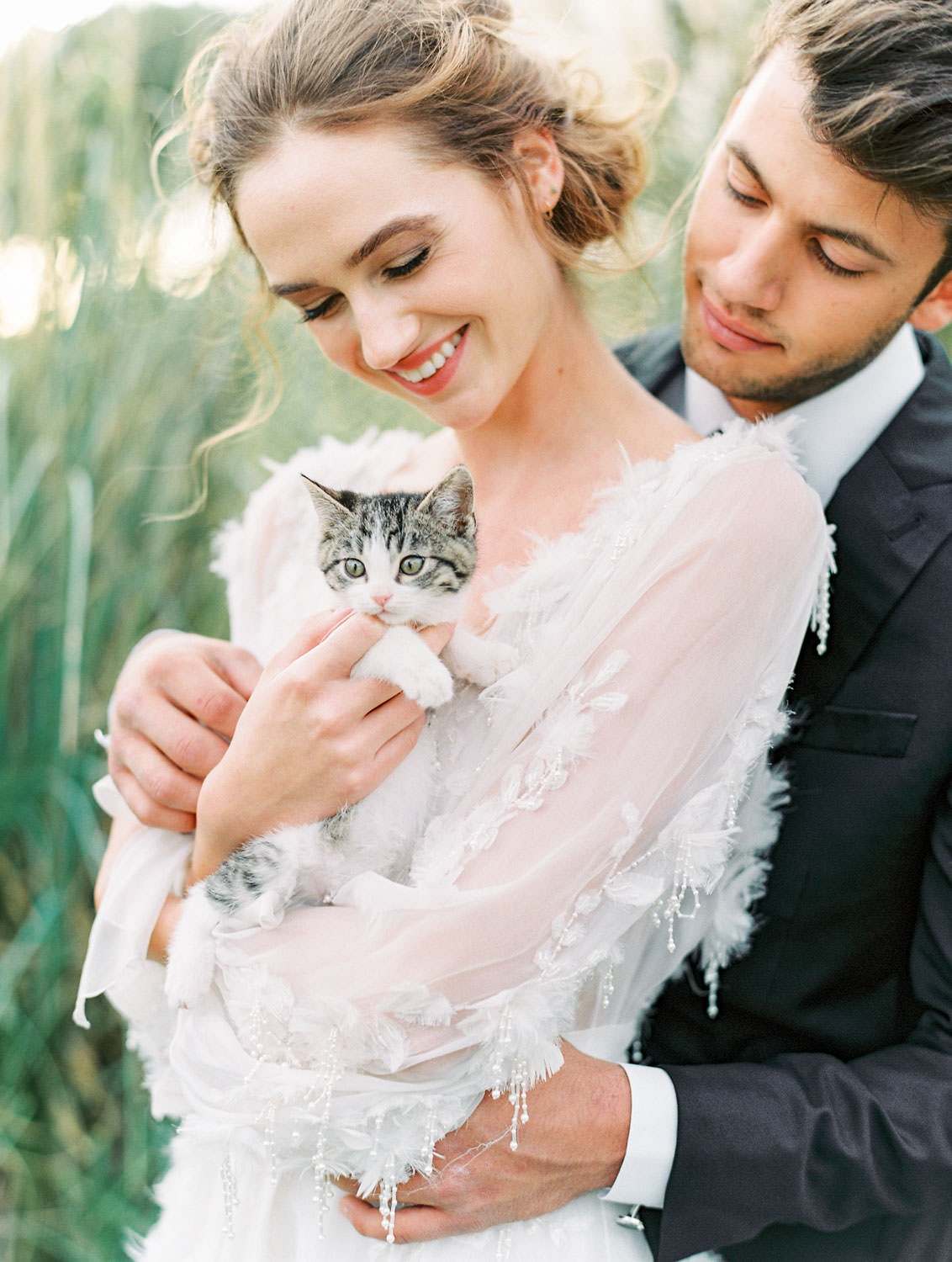 Bride in Marchesa Poppy gown and groom in The Black Tux holding a seven week old kitten, Pampas Grass Wedding in San Diego on Film by Cavin Elizabeth Photography