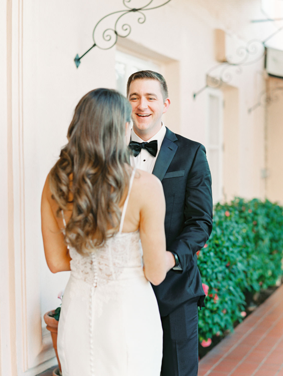 Bride and groom first look in front of pink wall, Intimate Wedding at La Valencia Hotel in La Jolla by Cavin Elizabeth Photography