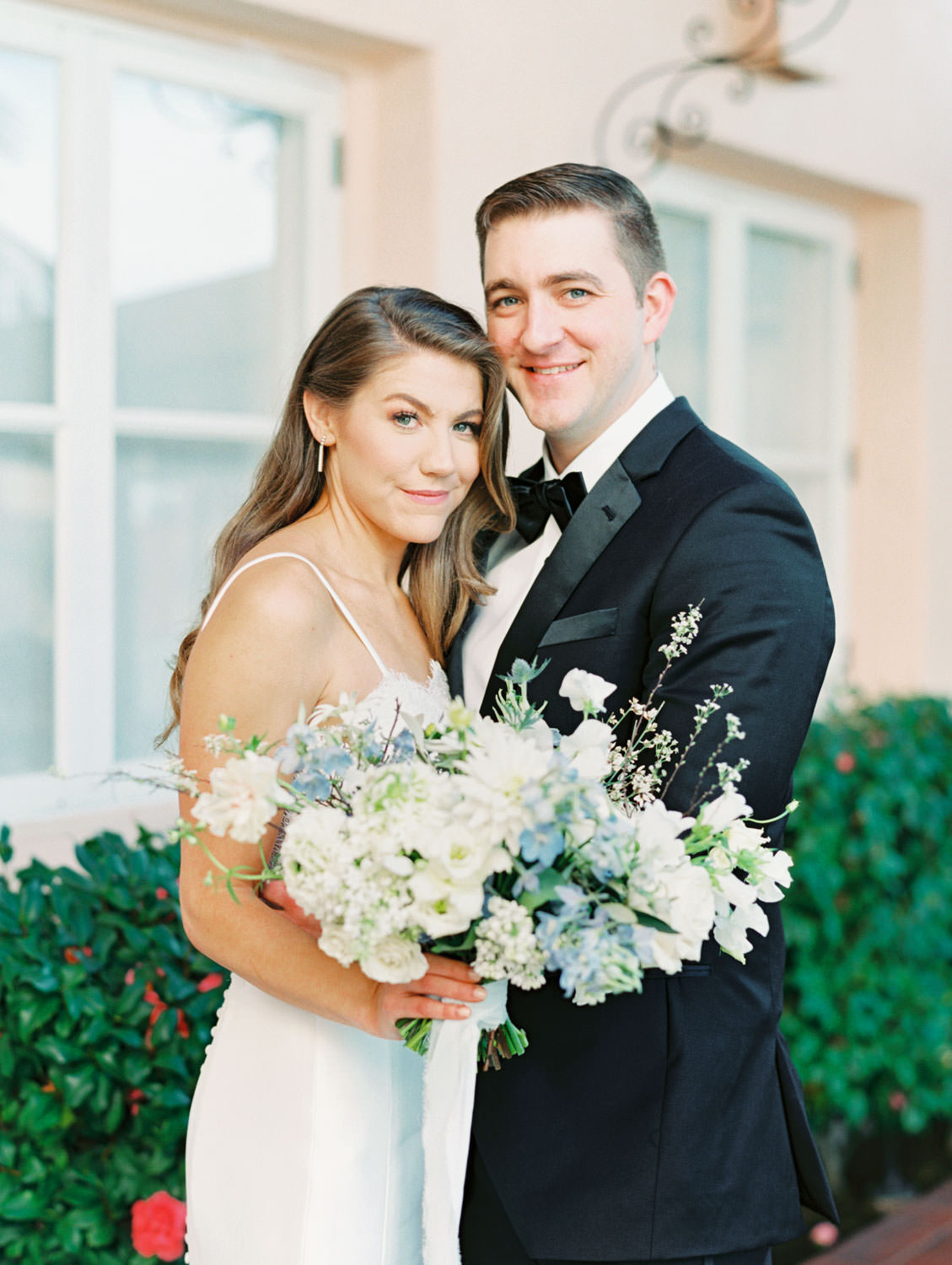 Bride and groom glamorous smiling at camera portrait with ivory and blue bridal bouquet on film, Intimate Wedding at La Valencia Hotel in La Jolla by Cavin Elizabeth Photography